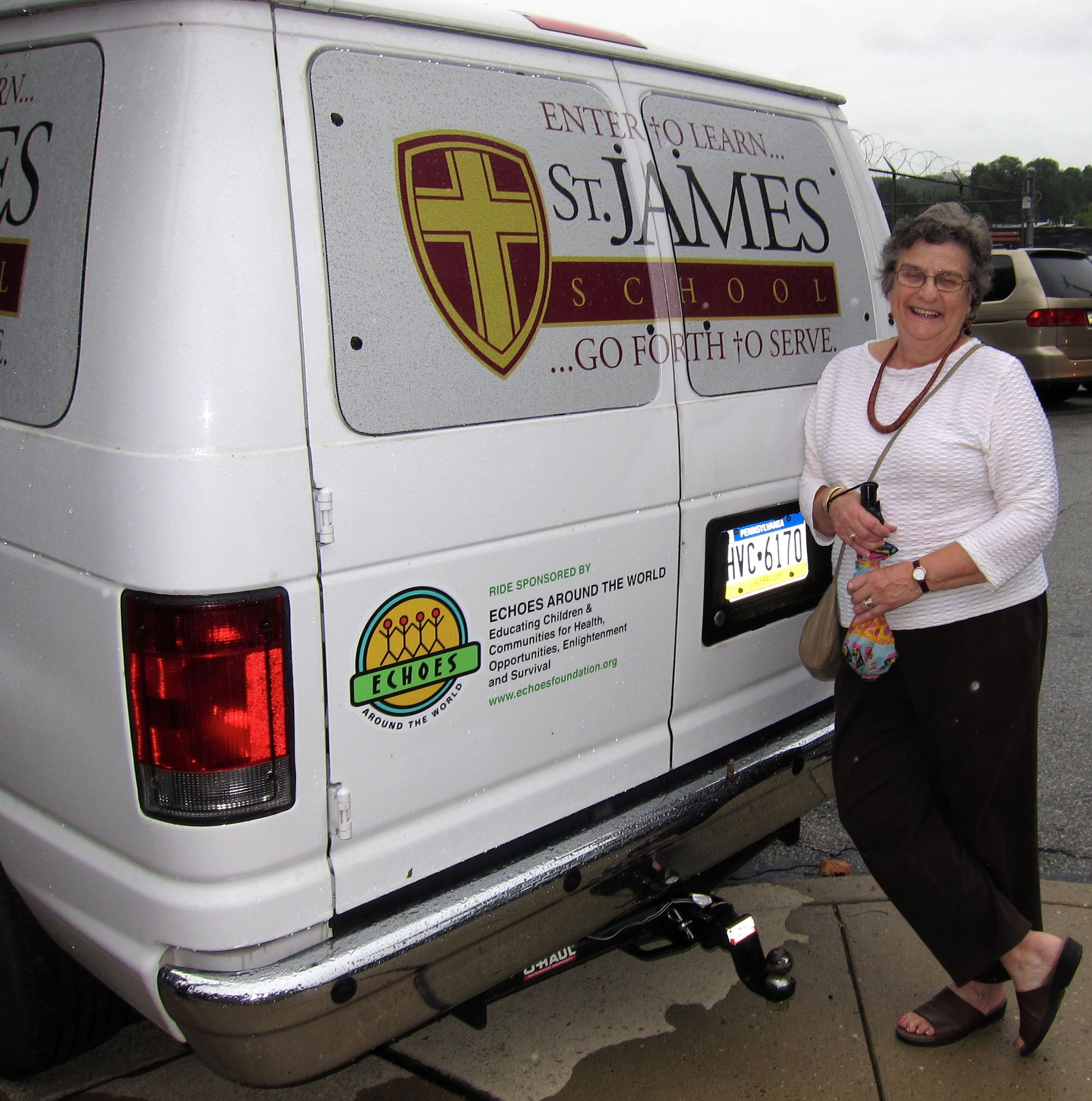 ECHOES co-founder Nereida Gordon stands by the van ECHOES donated to St. James School in North Philadelphia.