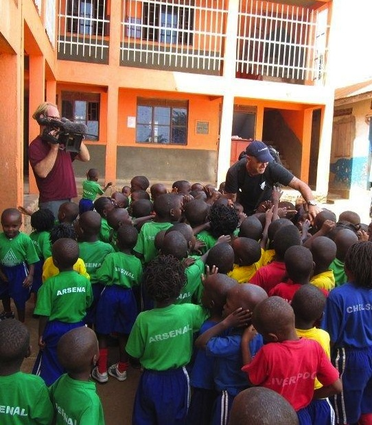 "A ""Dangerous Grounds"" cameraman captures Todd Carmichael greeting students at Trinity Children's Centre."