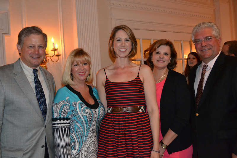 Enjoying ECHOES  Call to Care 2014: Building Futures  are auction co-chair Mona Kirby and her husband Brian, gala co-chairs Tory Holmwood and Anne Cunningham, and auctioneer Terry Cunningham.
