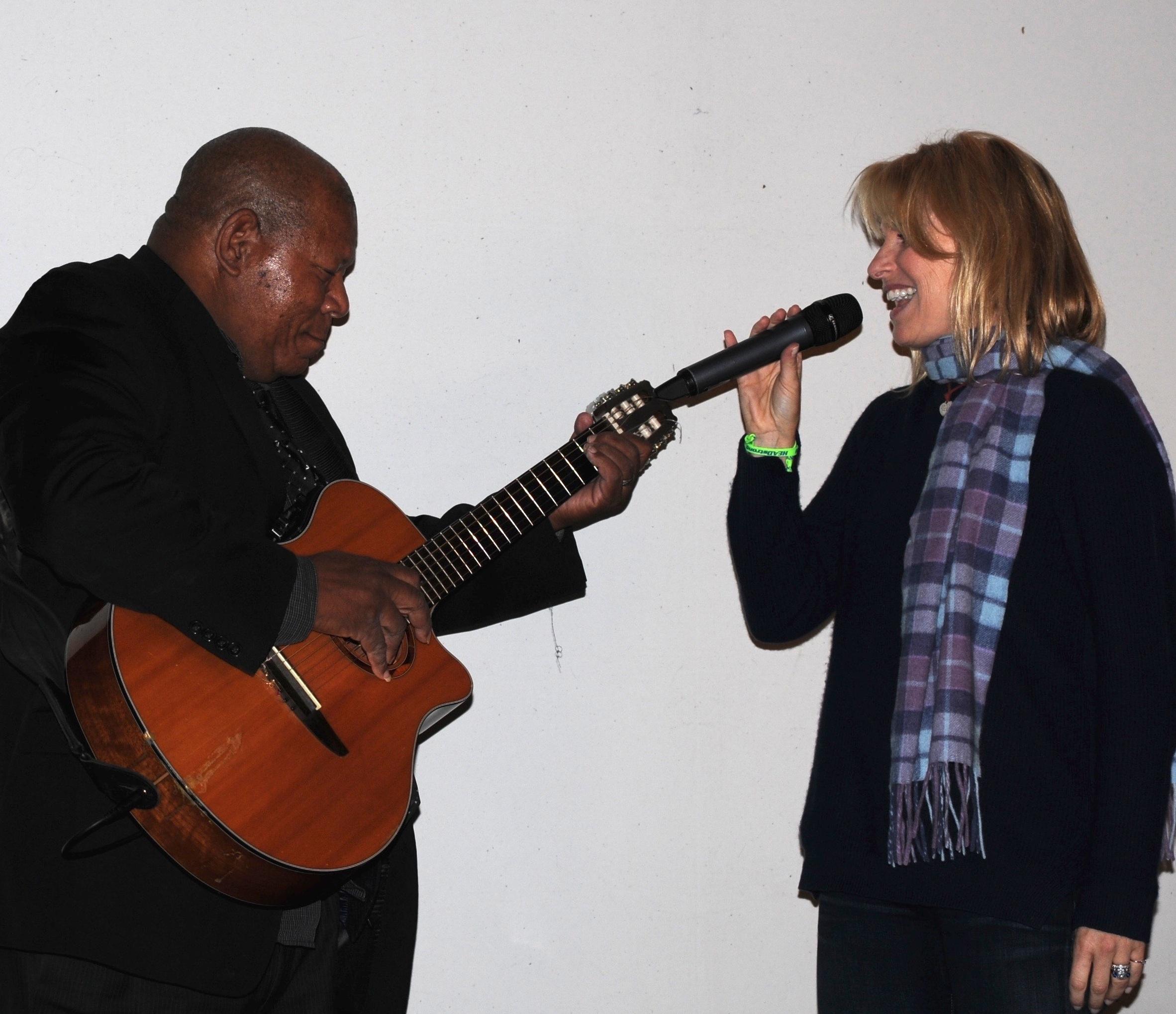 Flyers songstress Lauren Hart, an ECHOES Advisory Board member, joins Haitian guitarist Moe Cadet on stage.