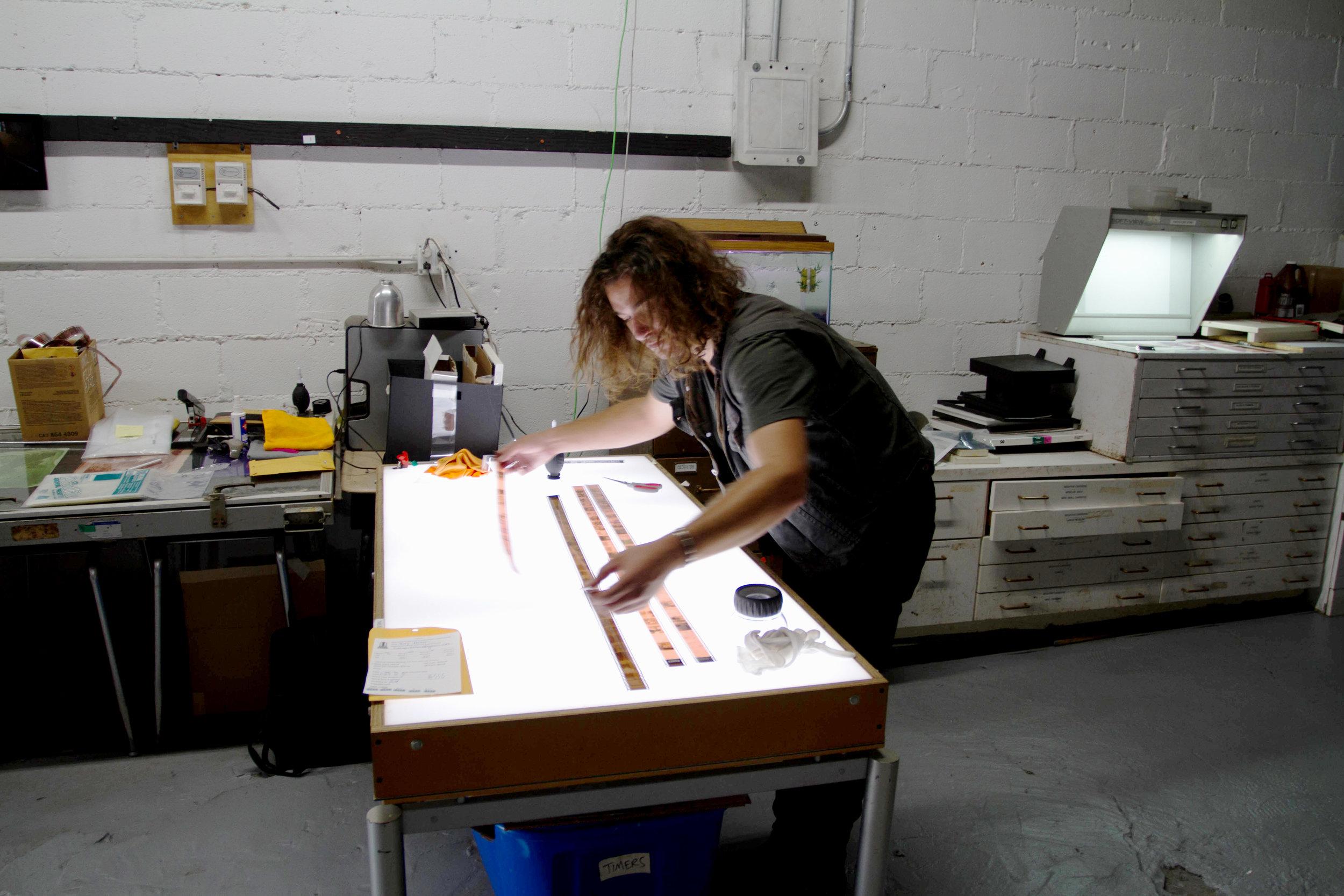 Volunteer Jon inspects some film