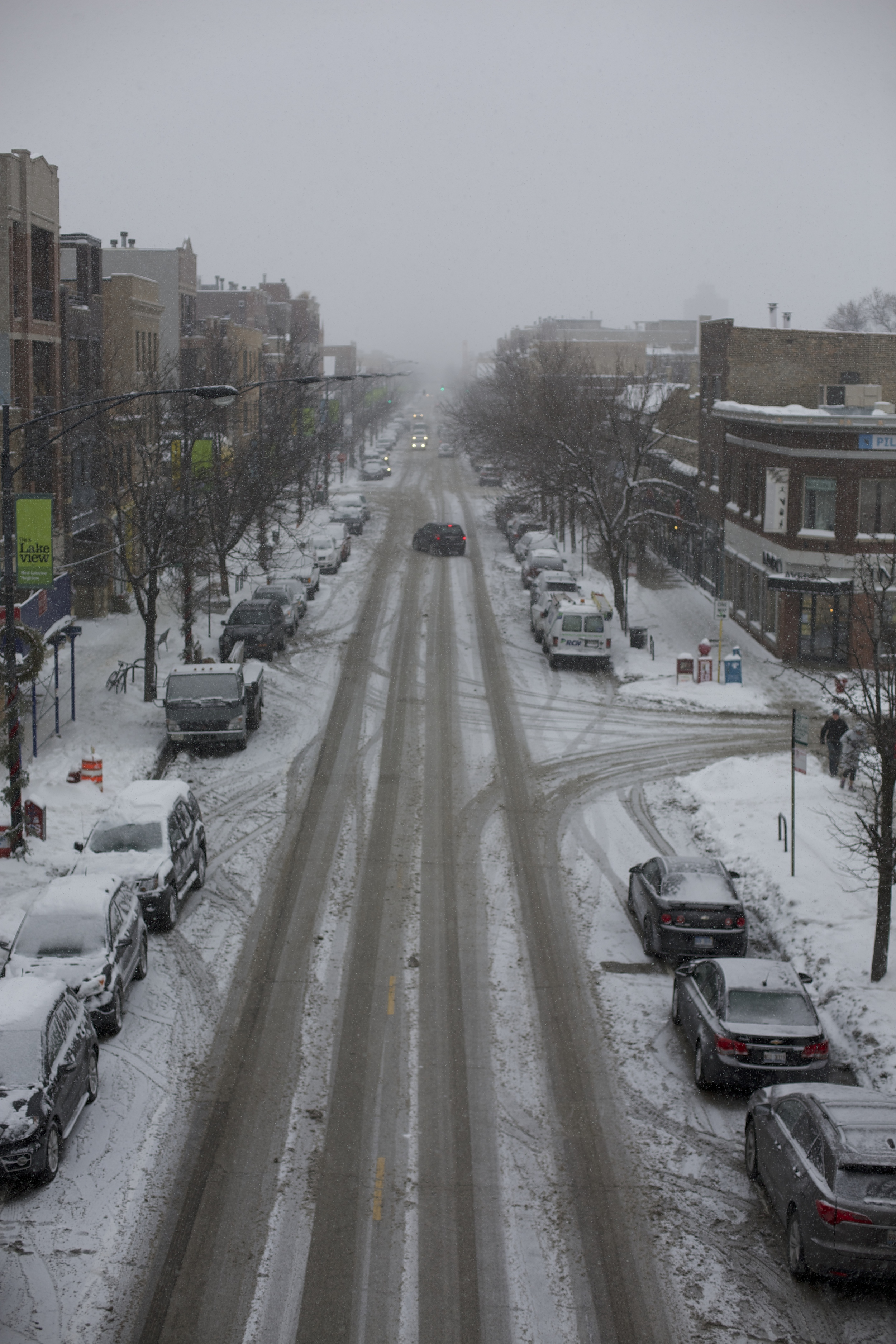The streets appear clear, but they are still covered in slippery slush despite the constant plowing
