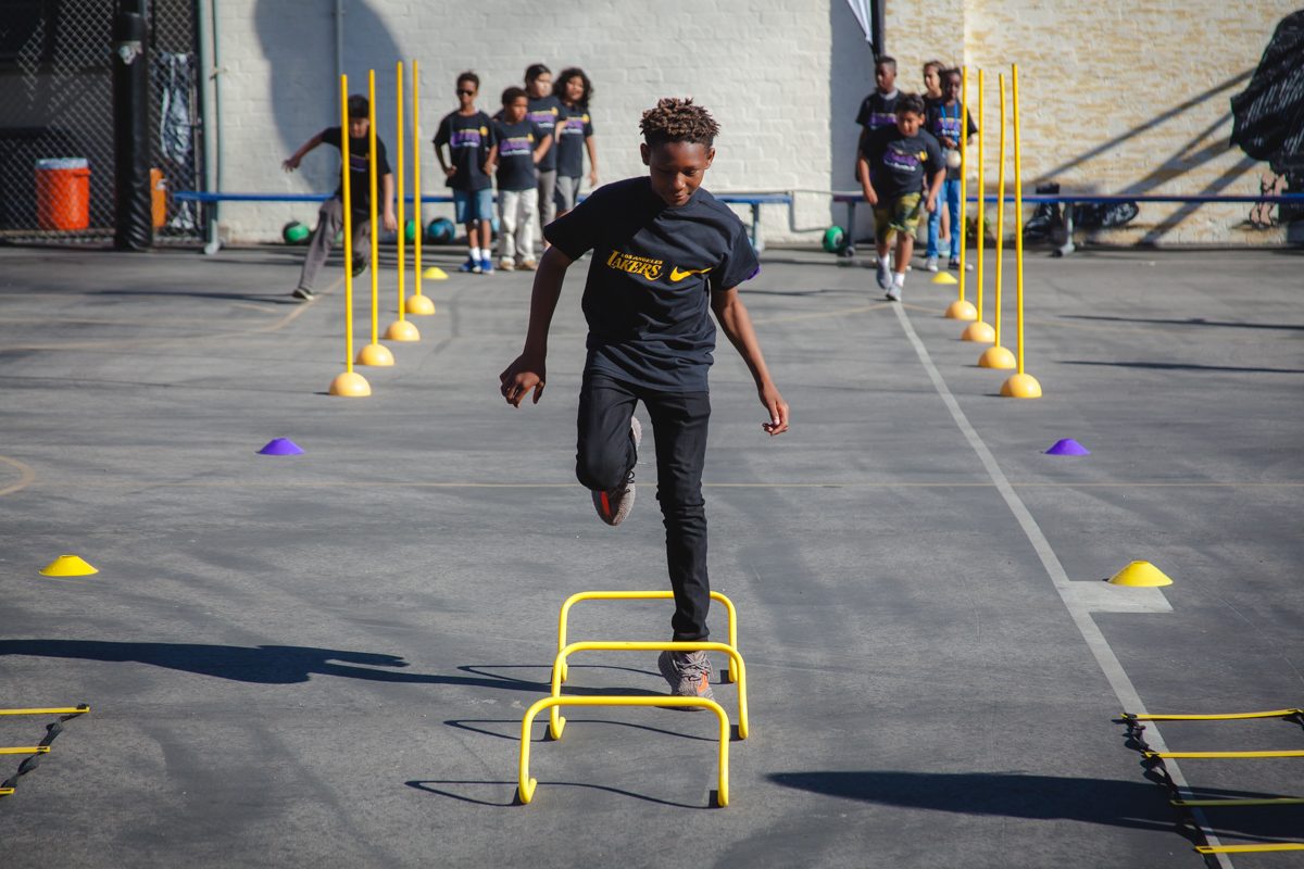 Club kids running drills at the Lakers Health & Fitness Camp, 2017.