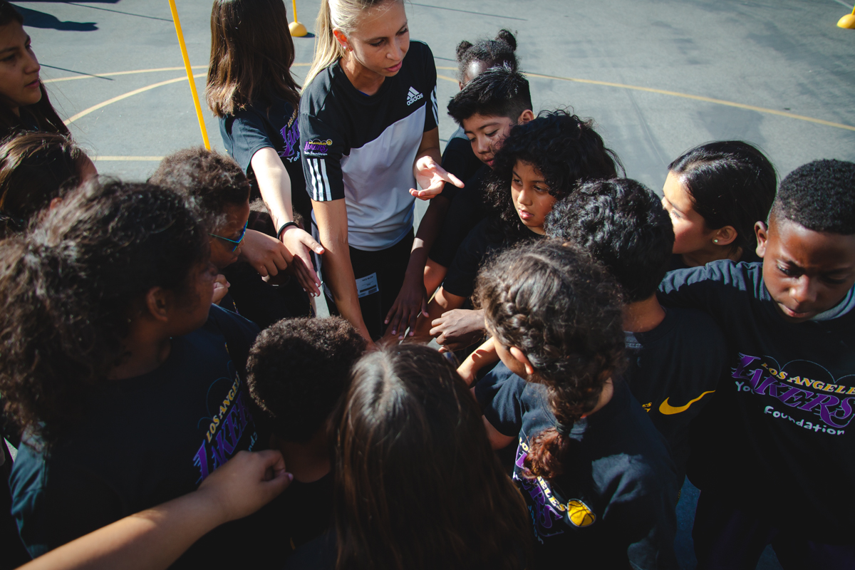 Coach bringing in the kids of the Santa Monica Boys & Girls Club during the Lakers Health & Fitness Camp.
