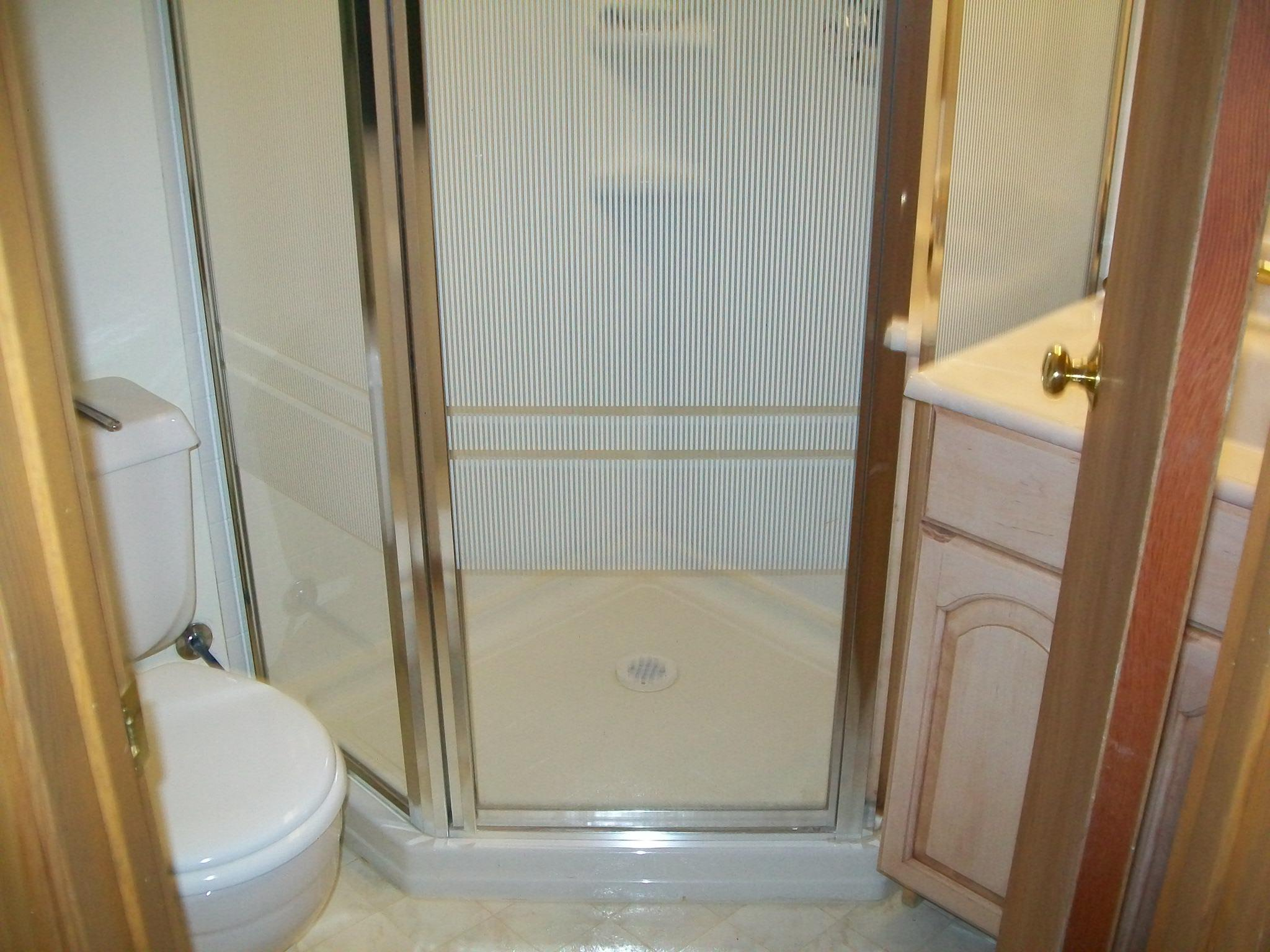 The shower is leaking under the flooring in the bathroom.