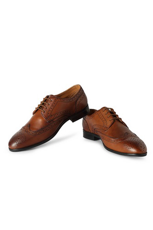 Navy suit and Brown Wingtip Brogues is not just a combination but a mark of style and good-taste.