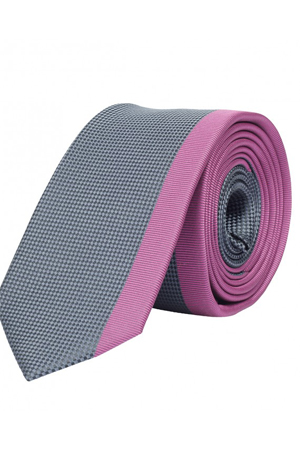 This grey and pink tie looks ultra stylish when worn with a charcoal grey suit.