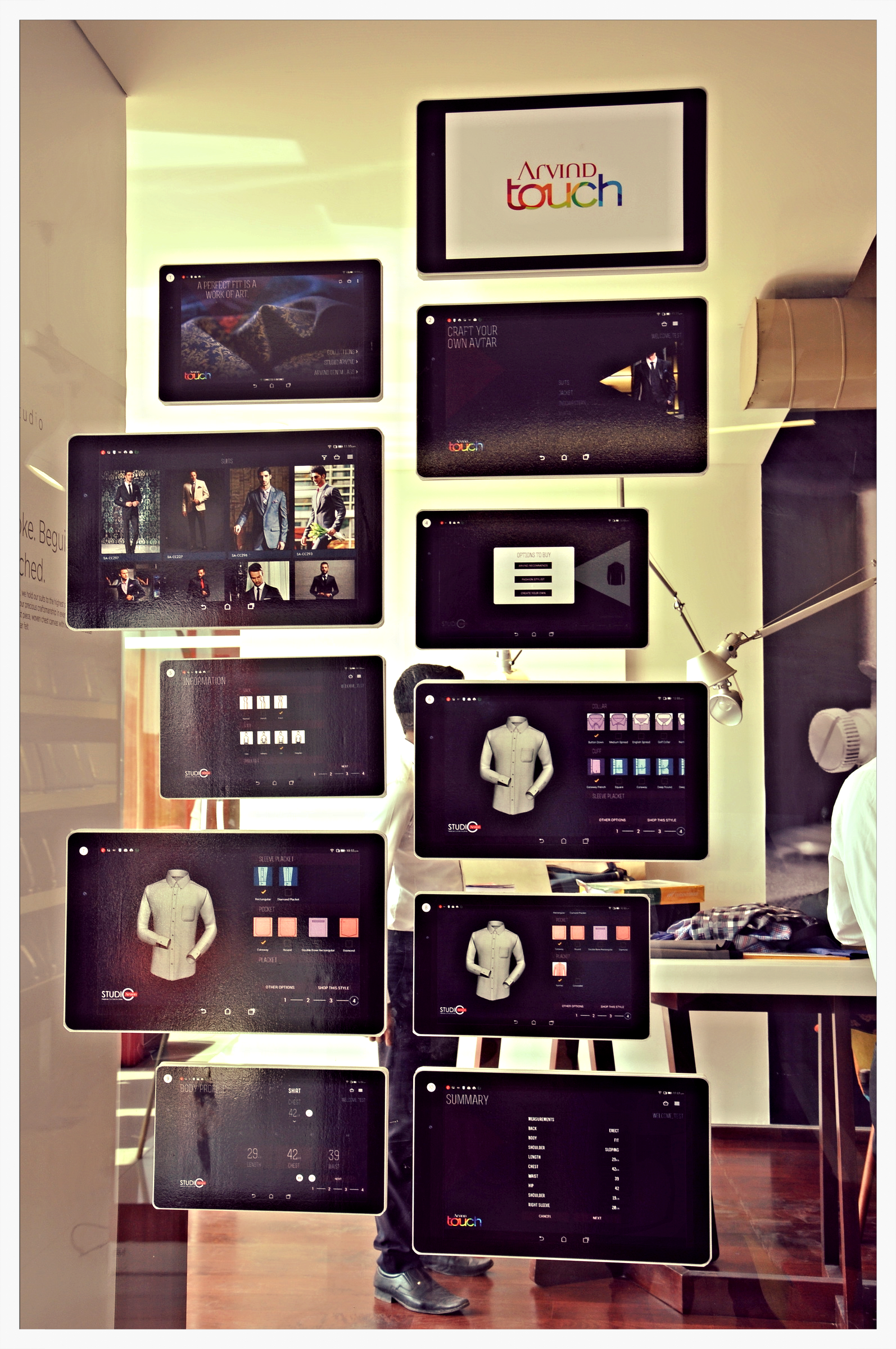Display of Snapshots of various pages of the app -TOUCH at The Arvind Store - Jayanagar, Bangalore.