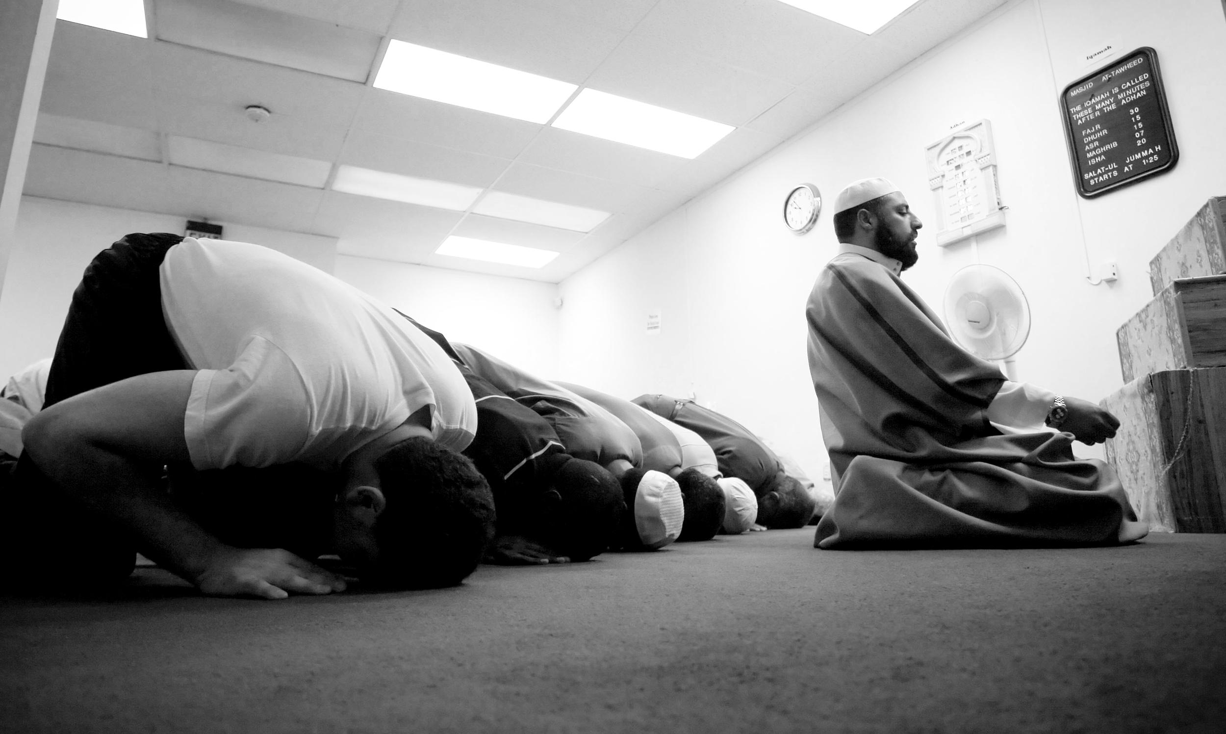 Muslim men praying in a mosque