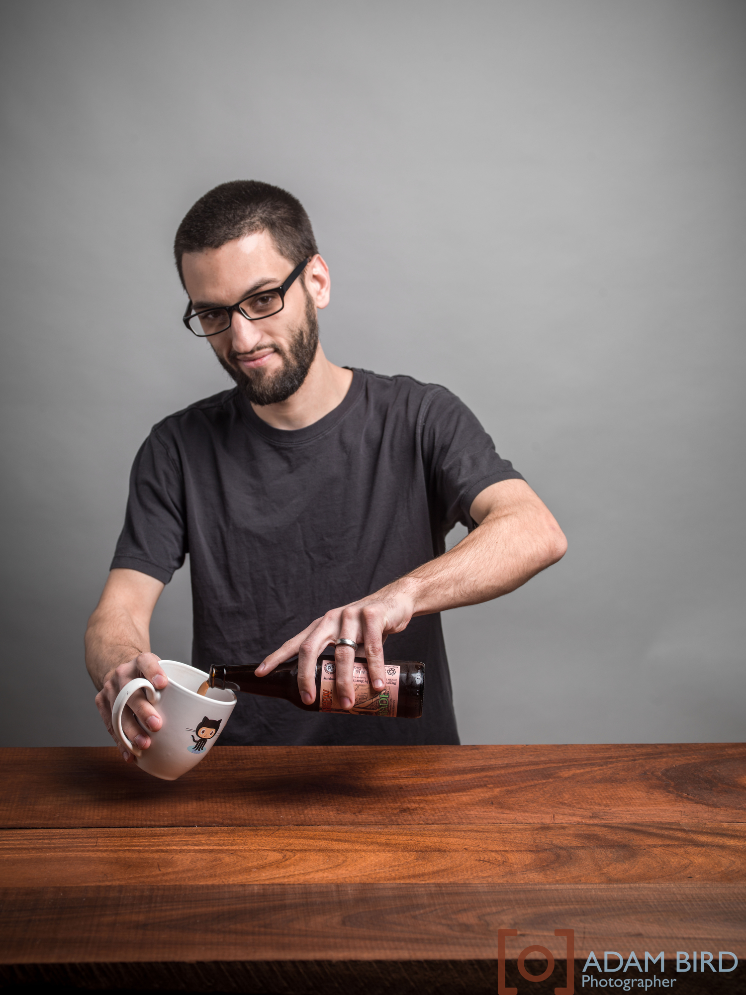 Tyler Steimle of K-Motion Design pouring a beer