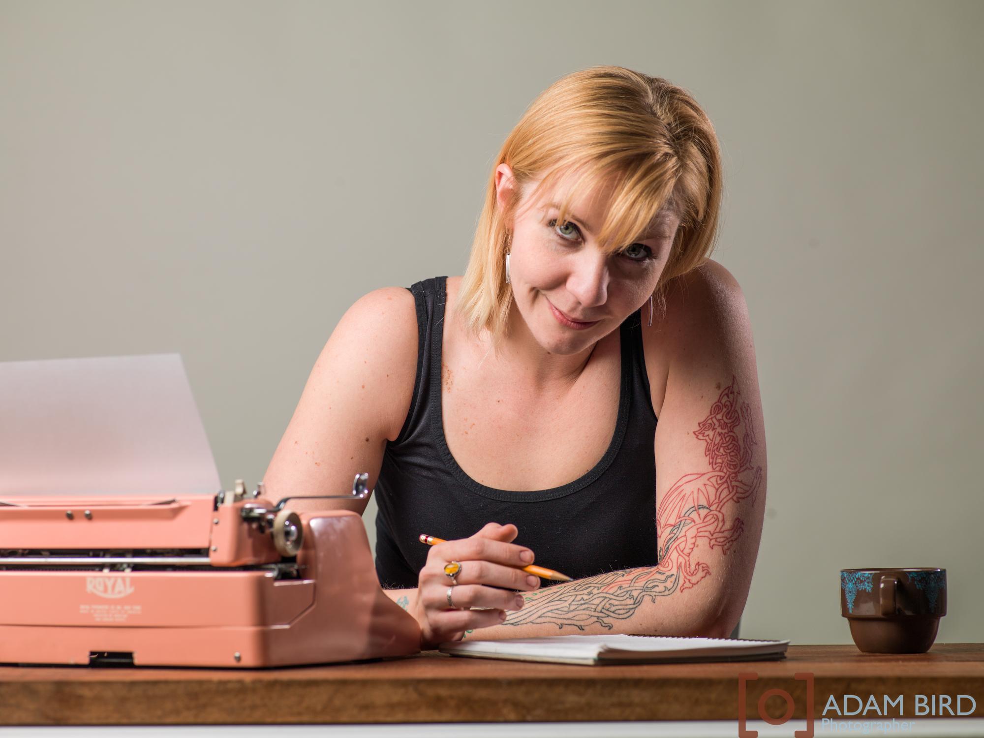 Marjorie Steele writing in the studio