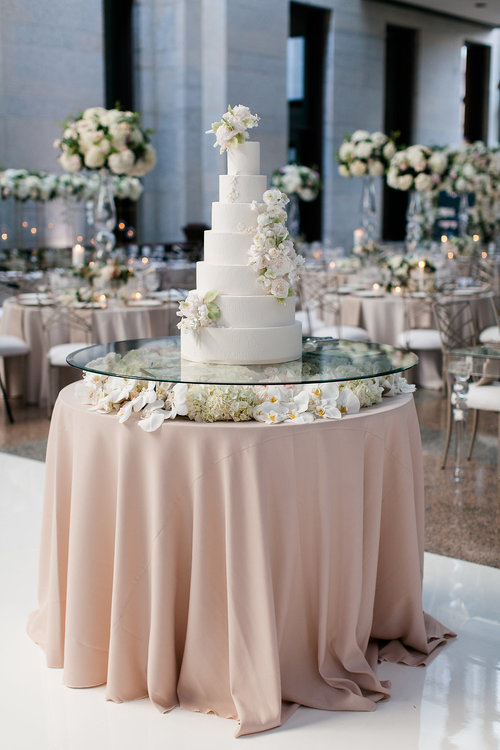 7 tiered wedding cake with hand sculpted sugar flowers