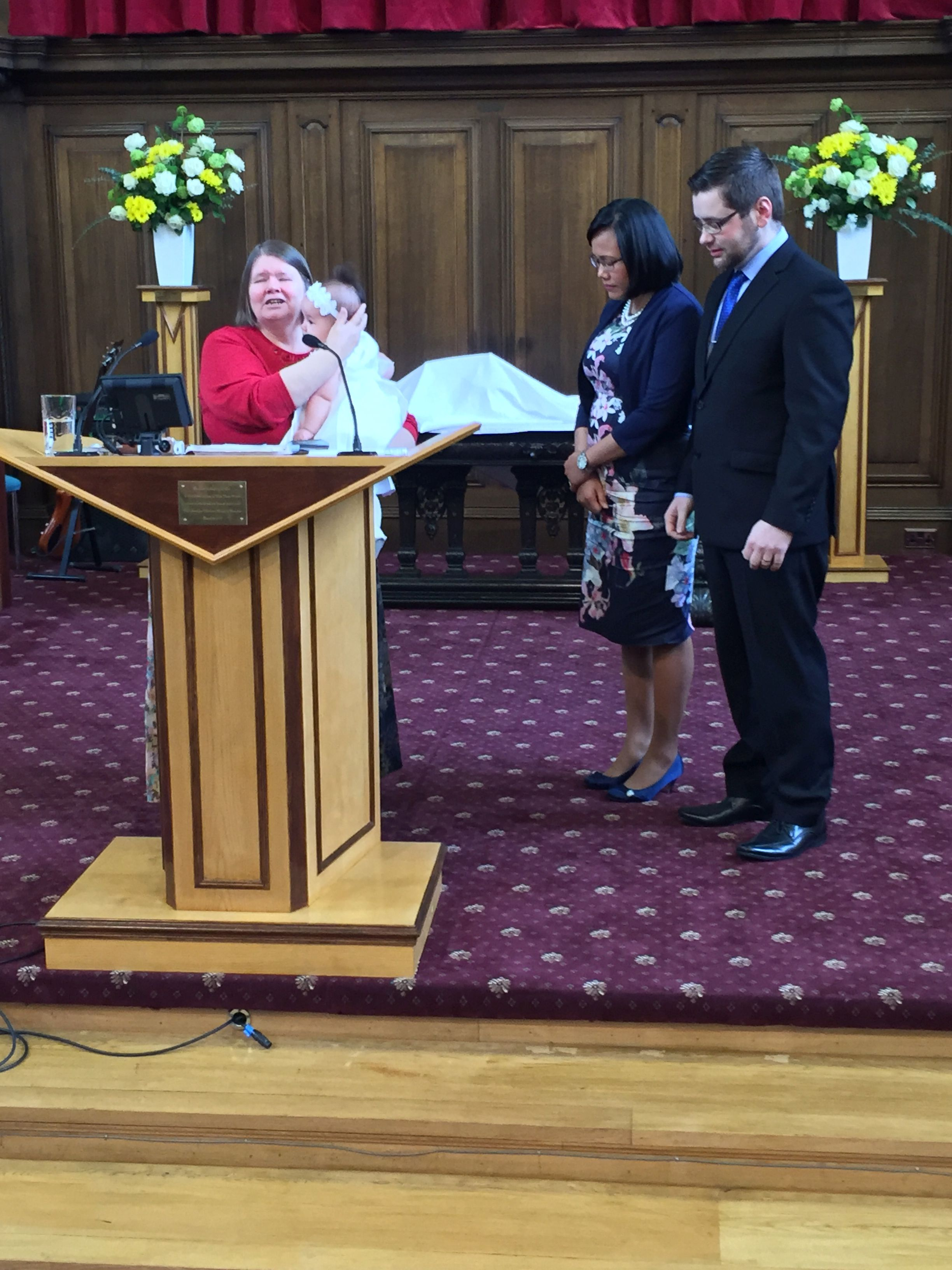 Alison Speirs praying with Sophia whith mum and dad standing beside them