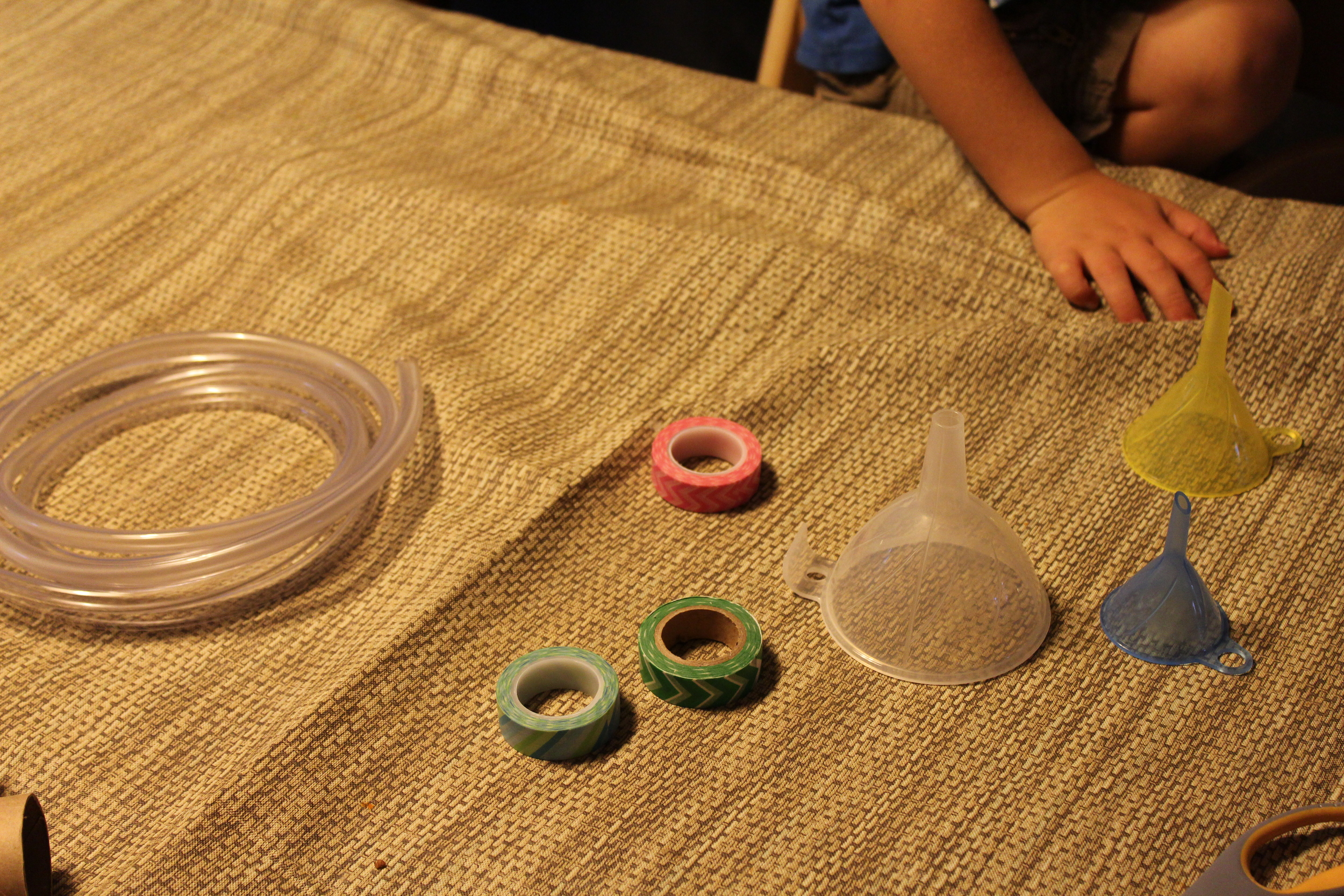 Our craft list included various sized funnels, plastic tubing, and washi tape for fun colors.