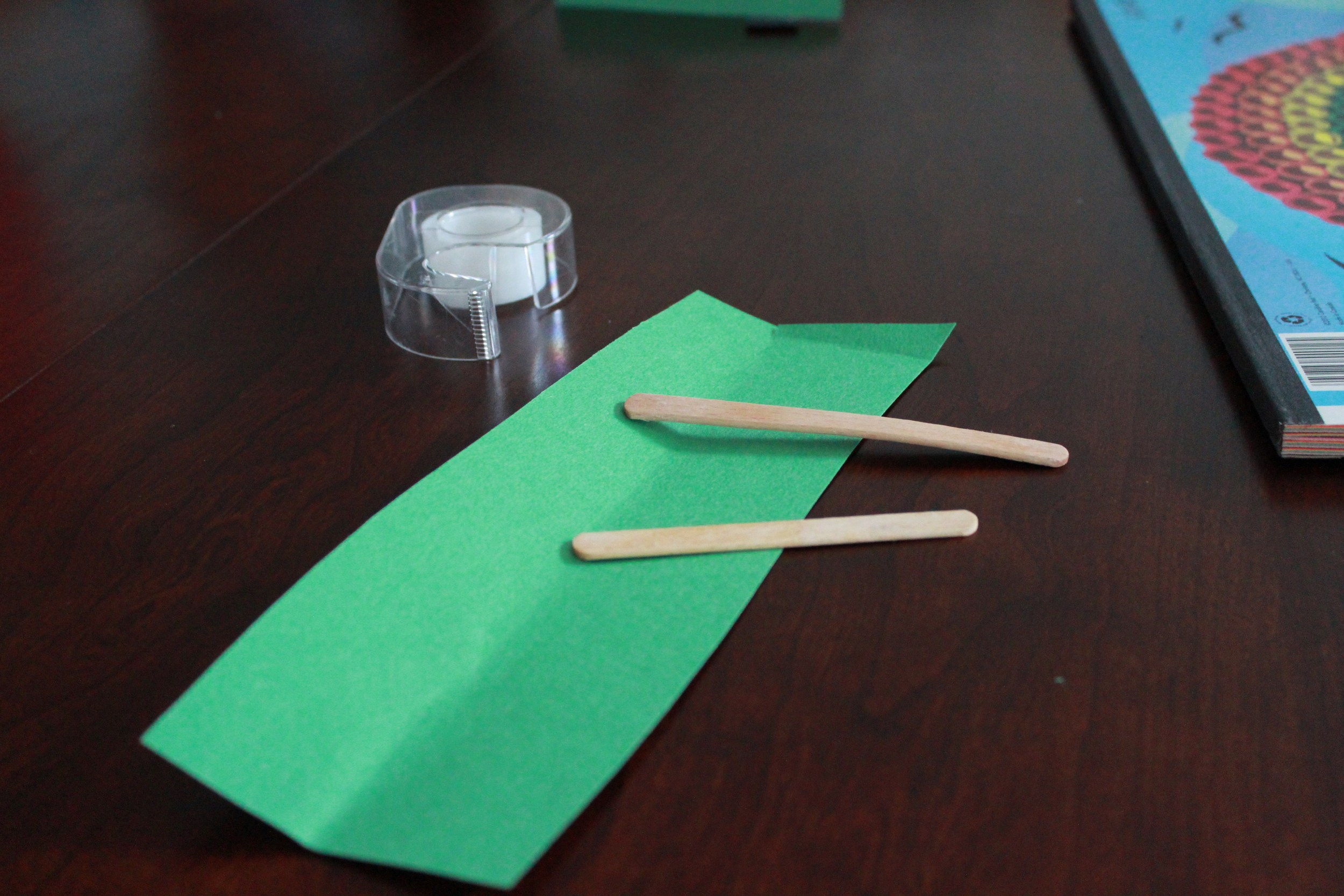 Supplies: Tape, popsicle sticks, construction paper.