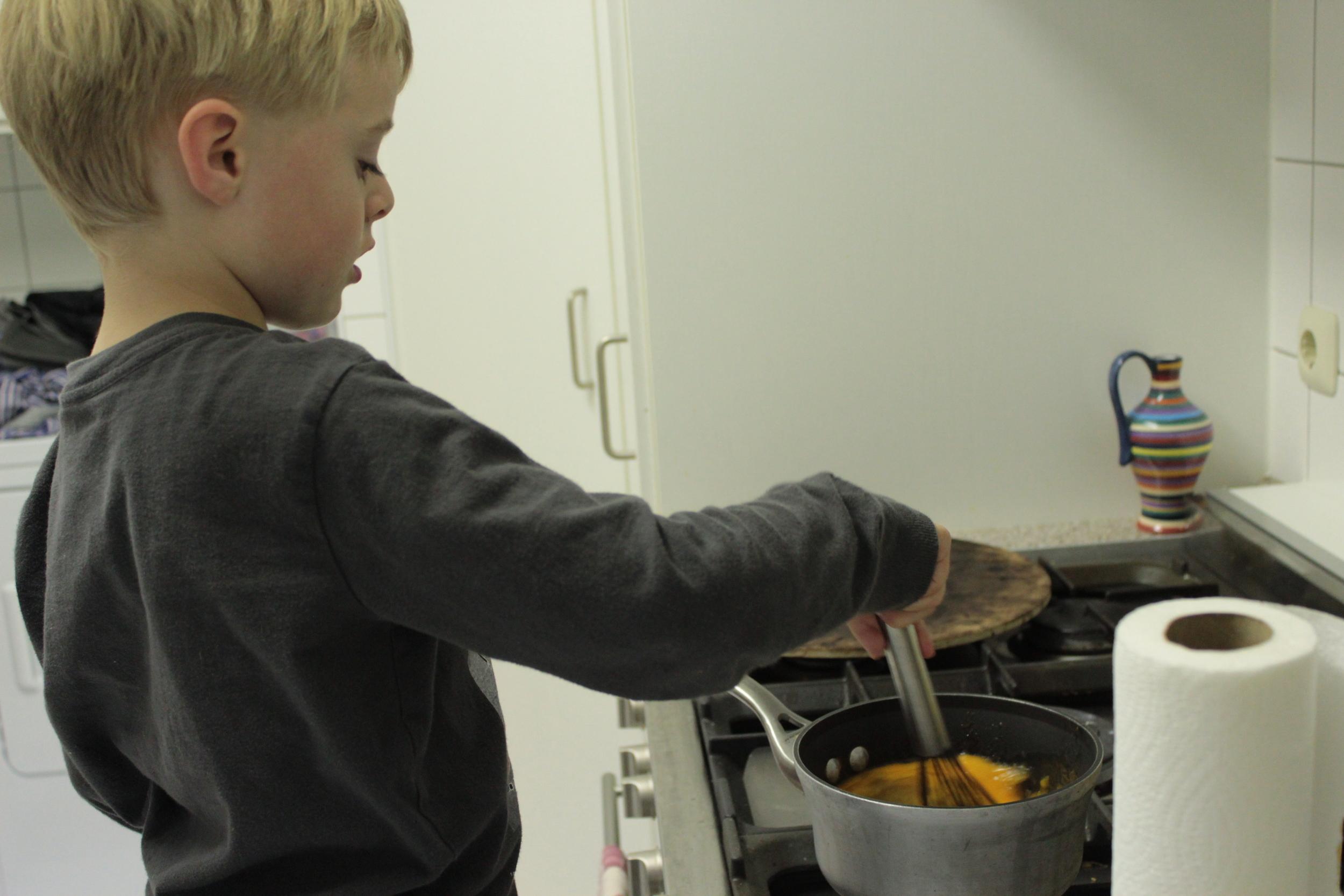 Mixing the sugar and yolk.