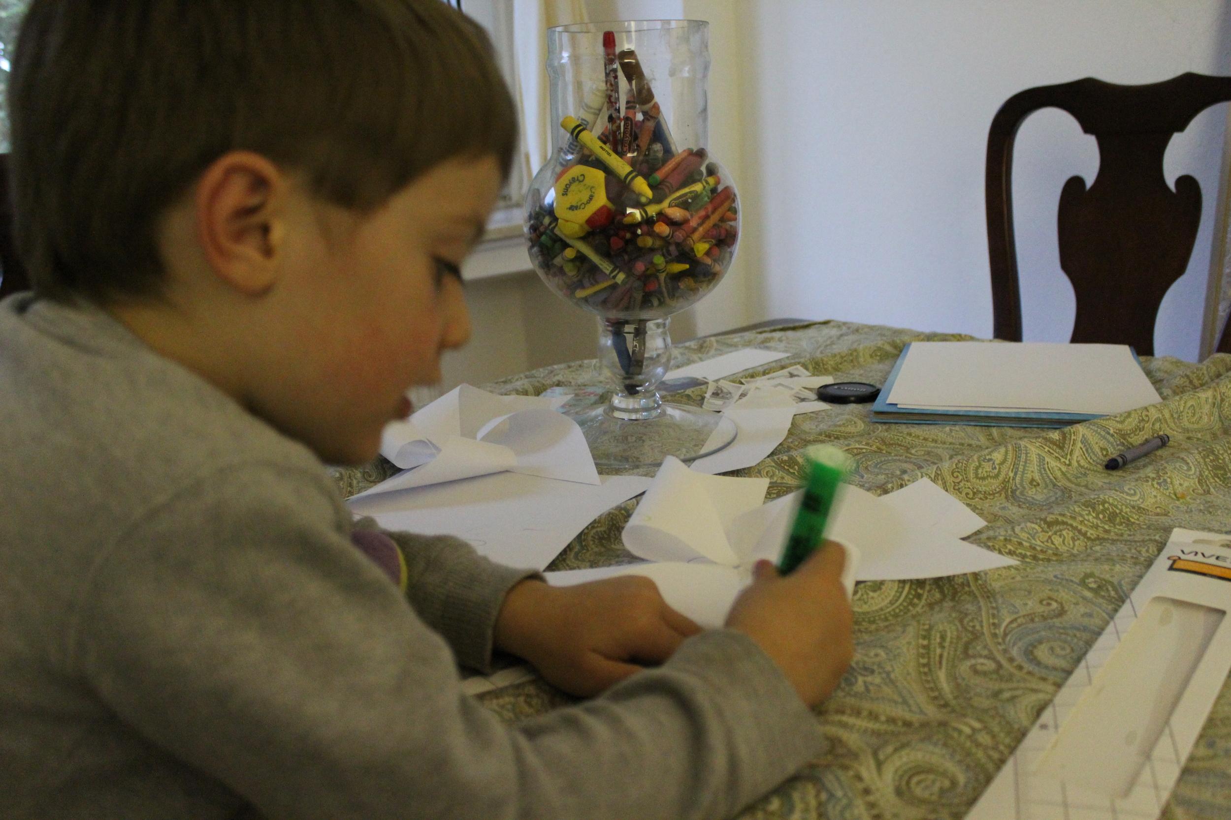 Decorating his pinwheel.