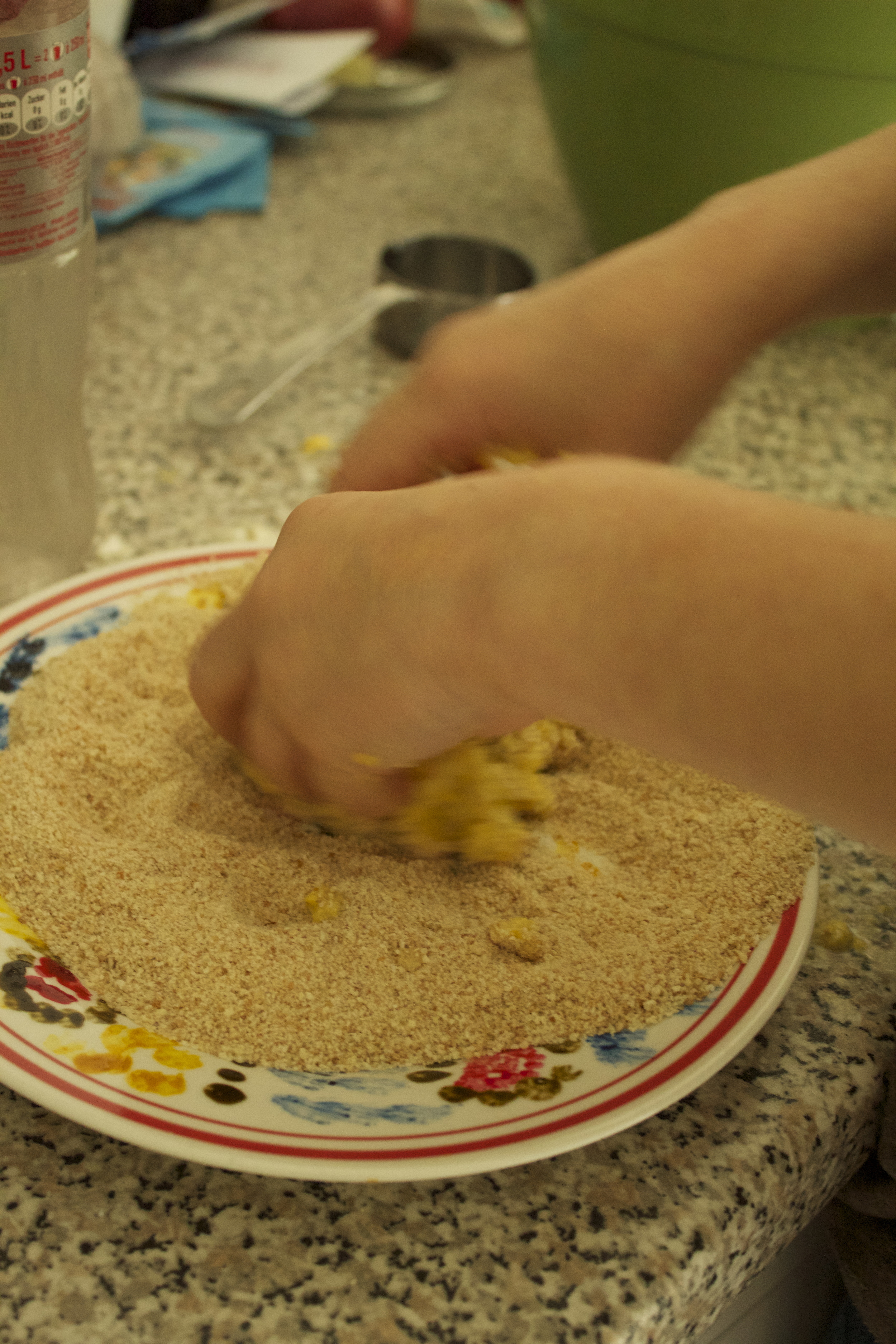 Coating with bread crumbs.