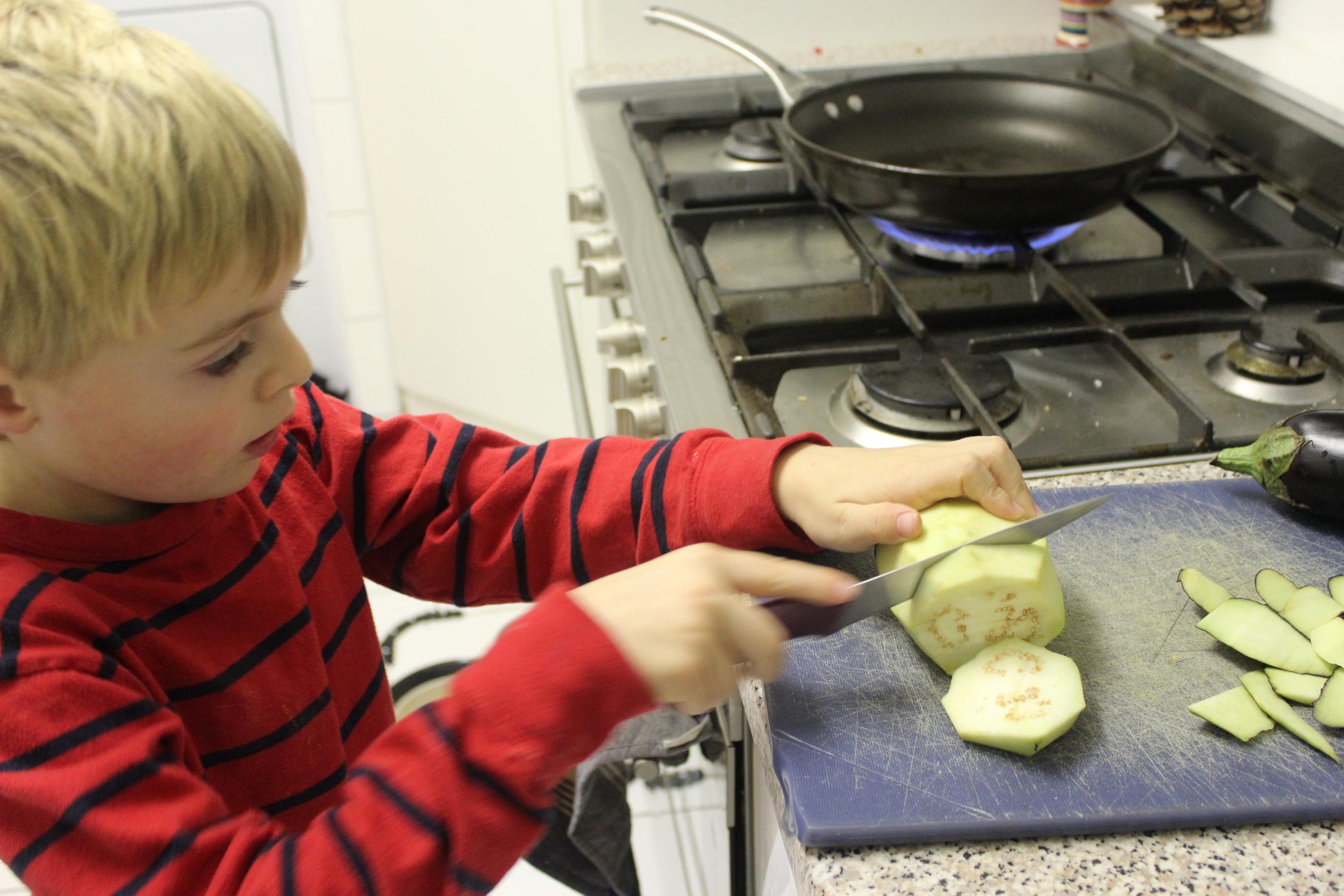 Cutting the peeled eggplant.