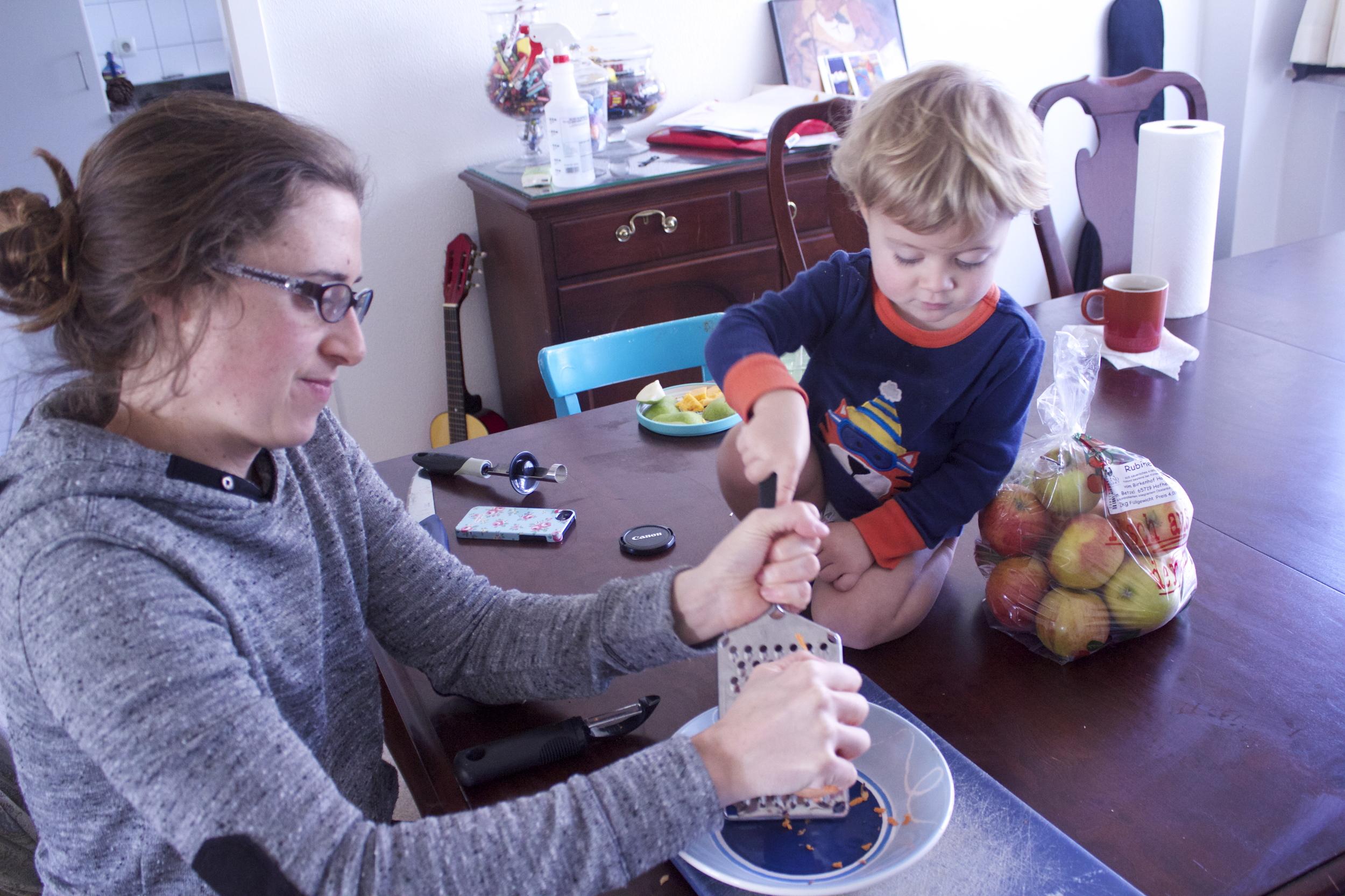 Potato shredding with baby supervision.