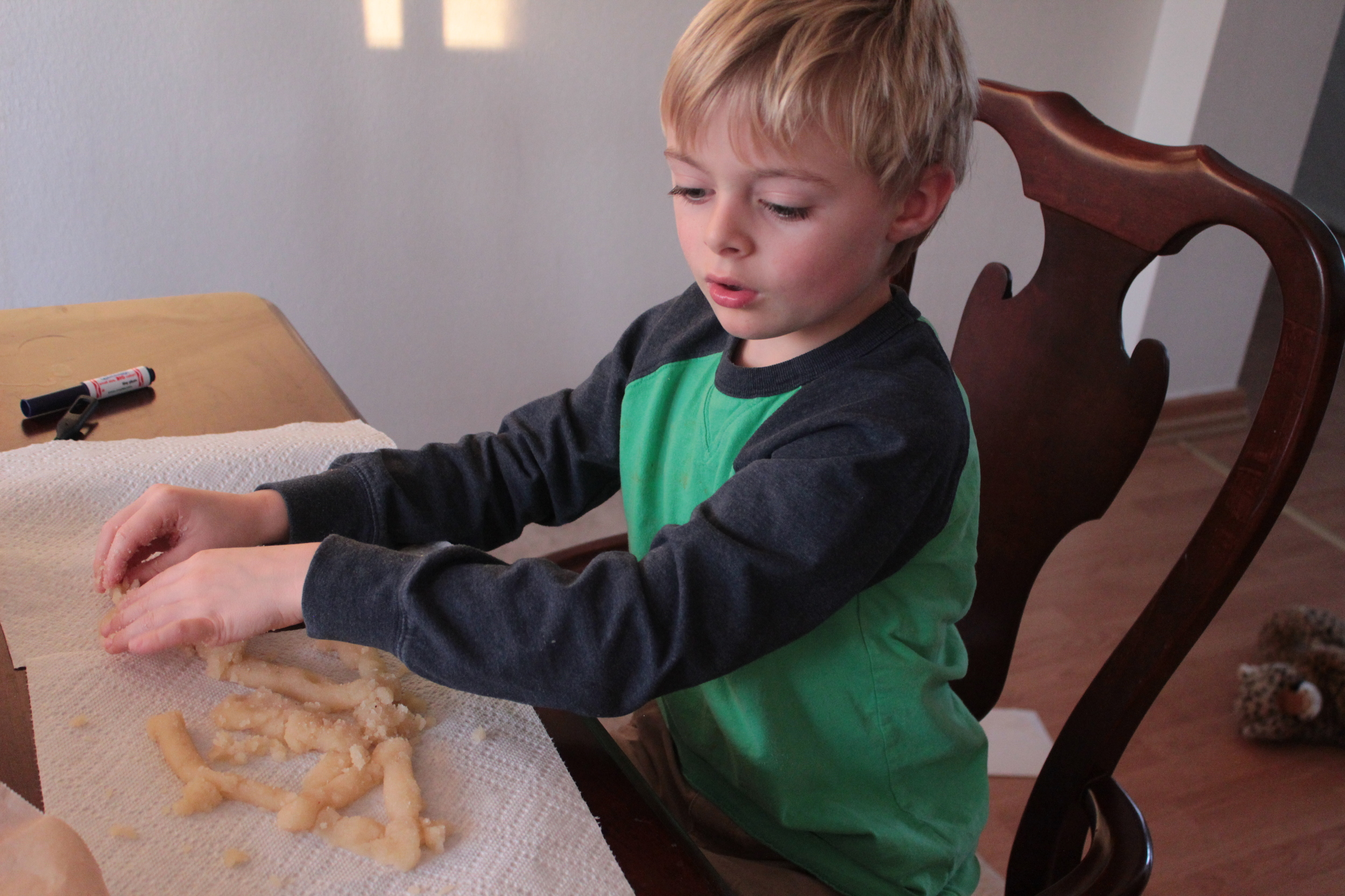 Shaping his marzipan into a hovercraft