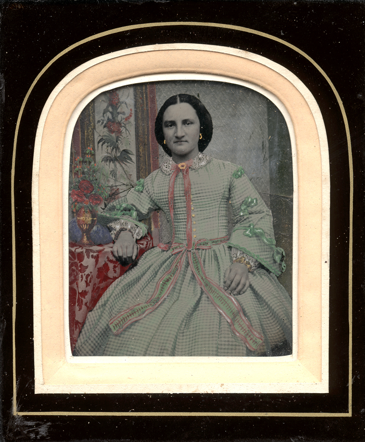 Portrait of a Seated Woman Resting her Arm on Round Table