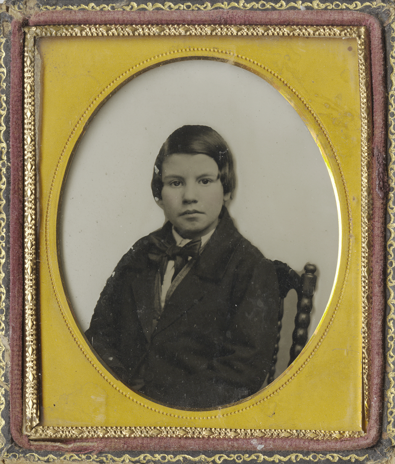 Portrait of Young Boy in Satin Bowtie