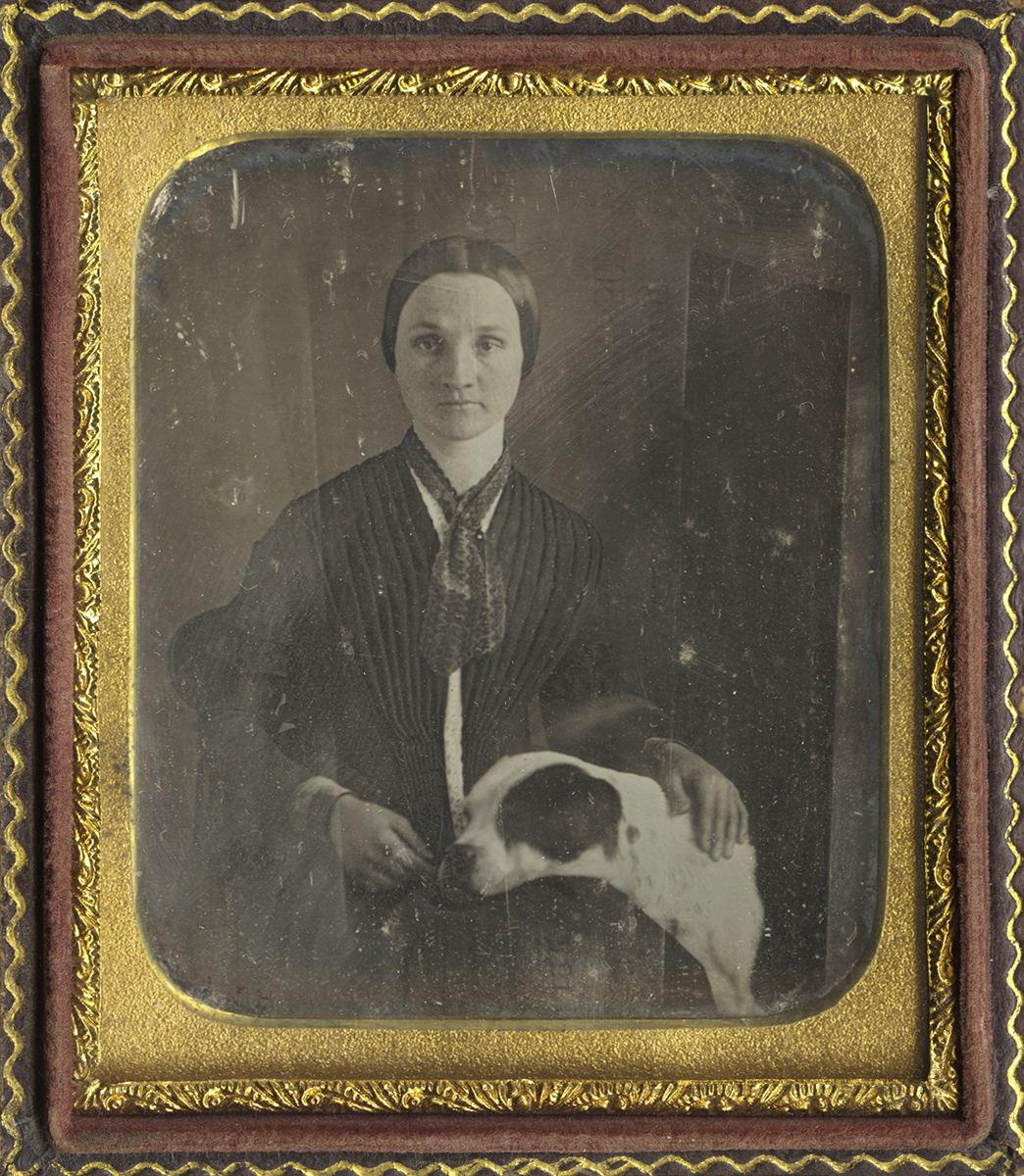Portrait of a Lady with a Large Dog Resting Its Head on Her Lap