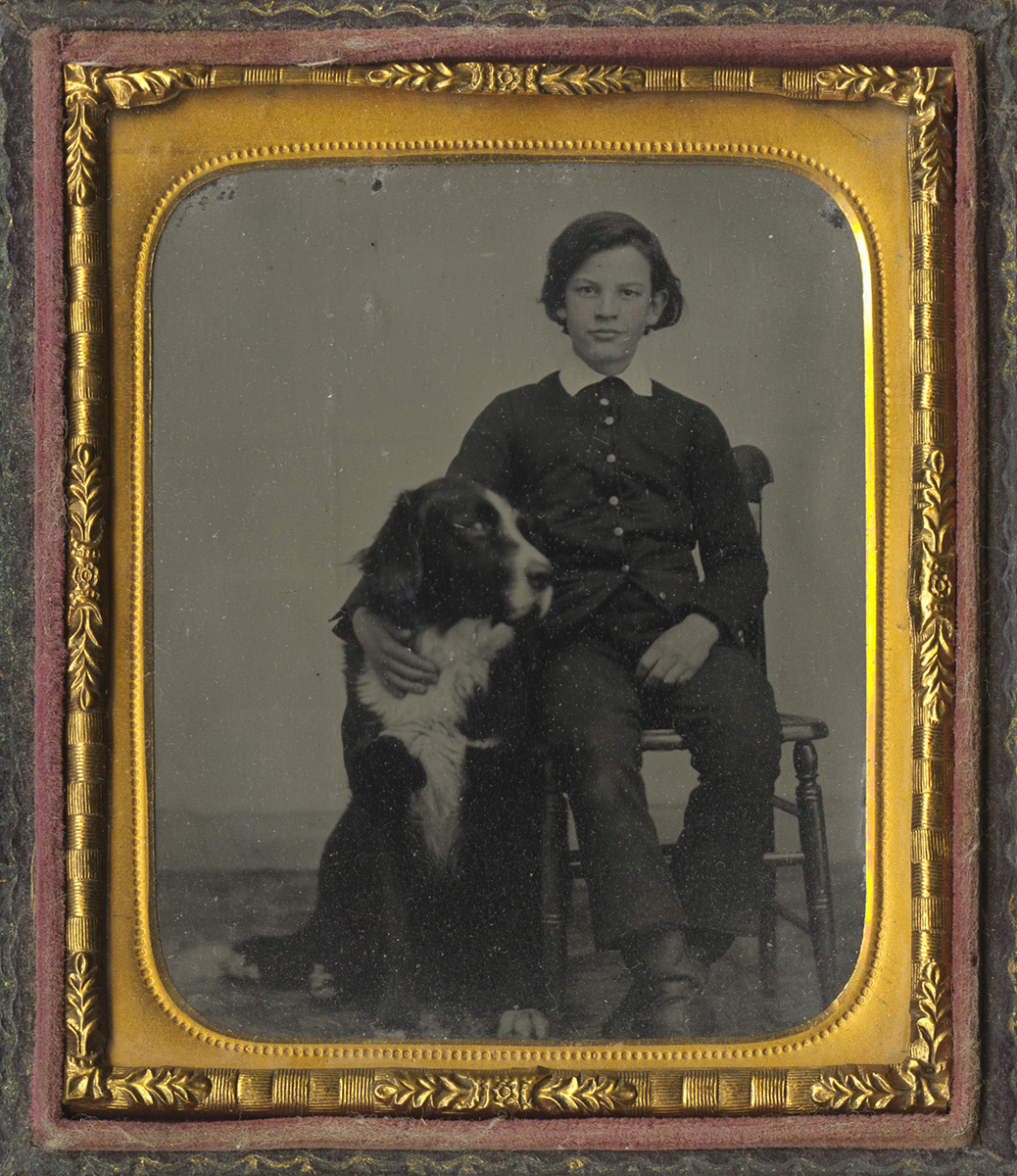 Portrait of a Boy Seated Next to His Burmese Mountain Dog