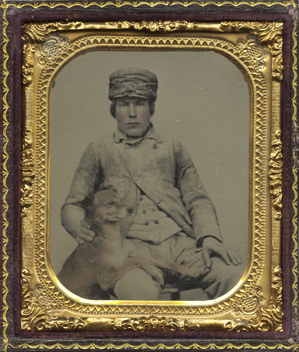 Portrait of Young Cadet with Dog