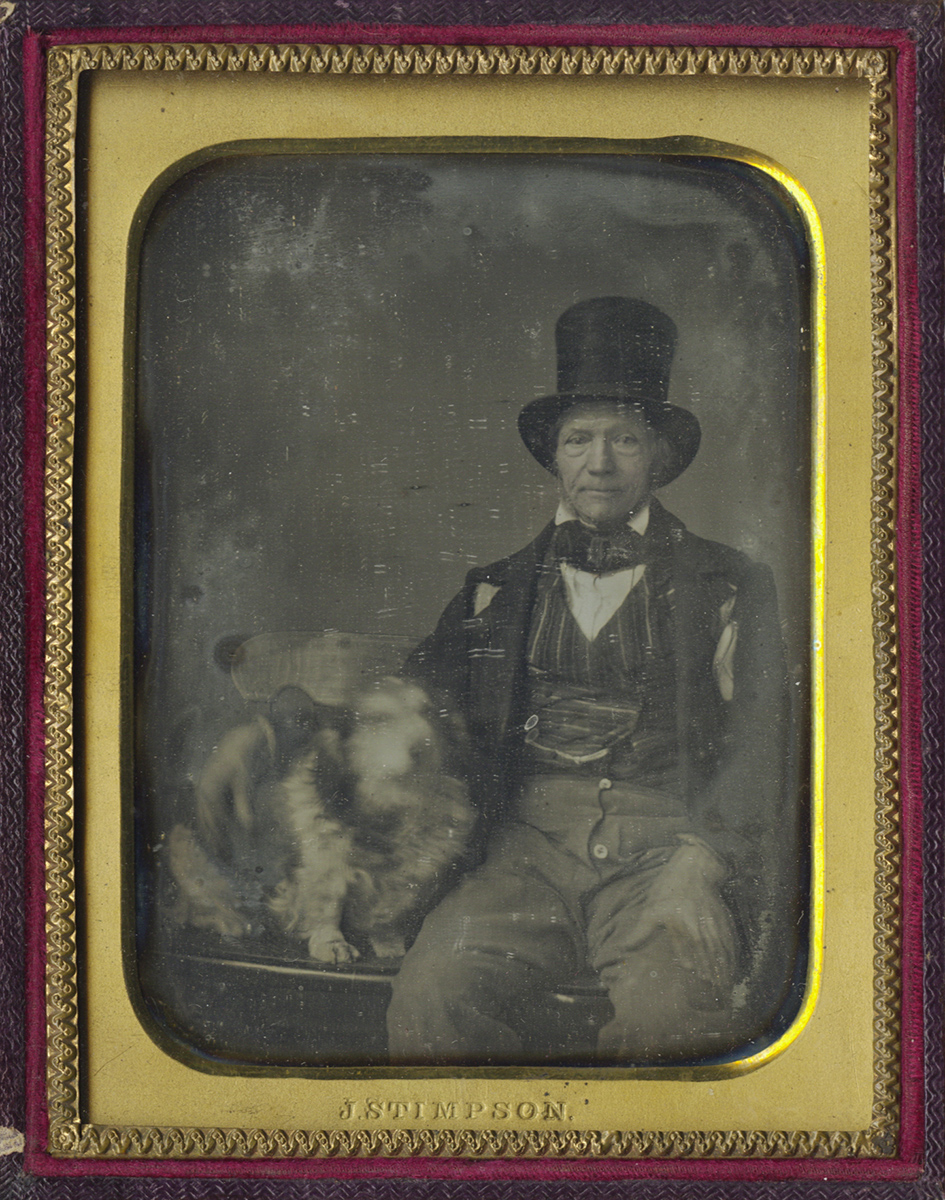 Man in Top Hat Seated Next to his Dog