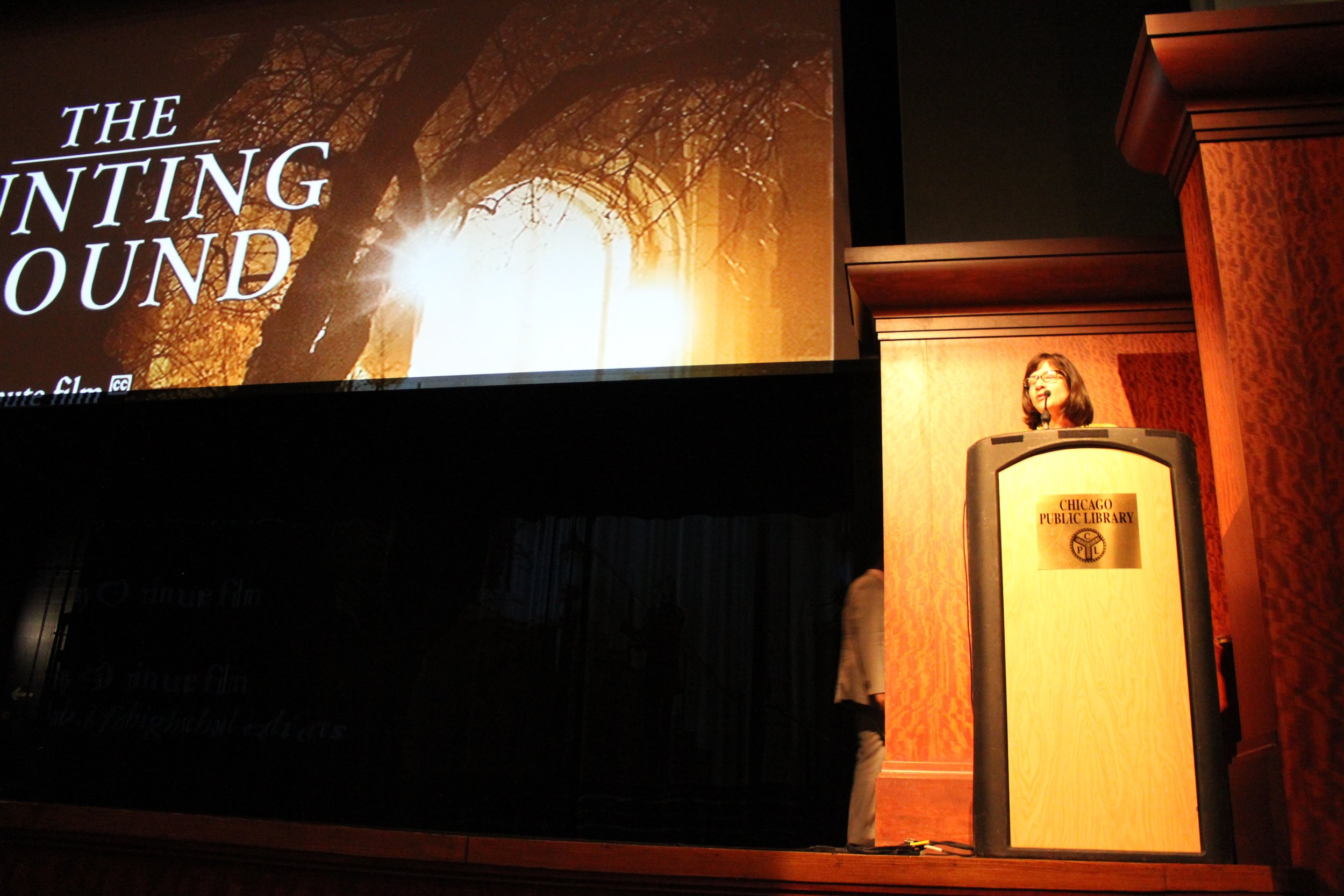"""Chicago Says No More founder, Kristie Paskvan addresses the crowd at """"The Hunting Ground"""" screening at Harold Washington Library"""