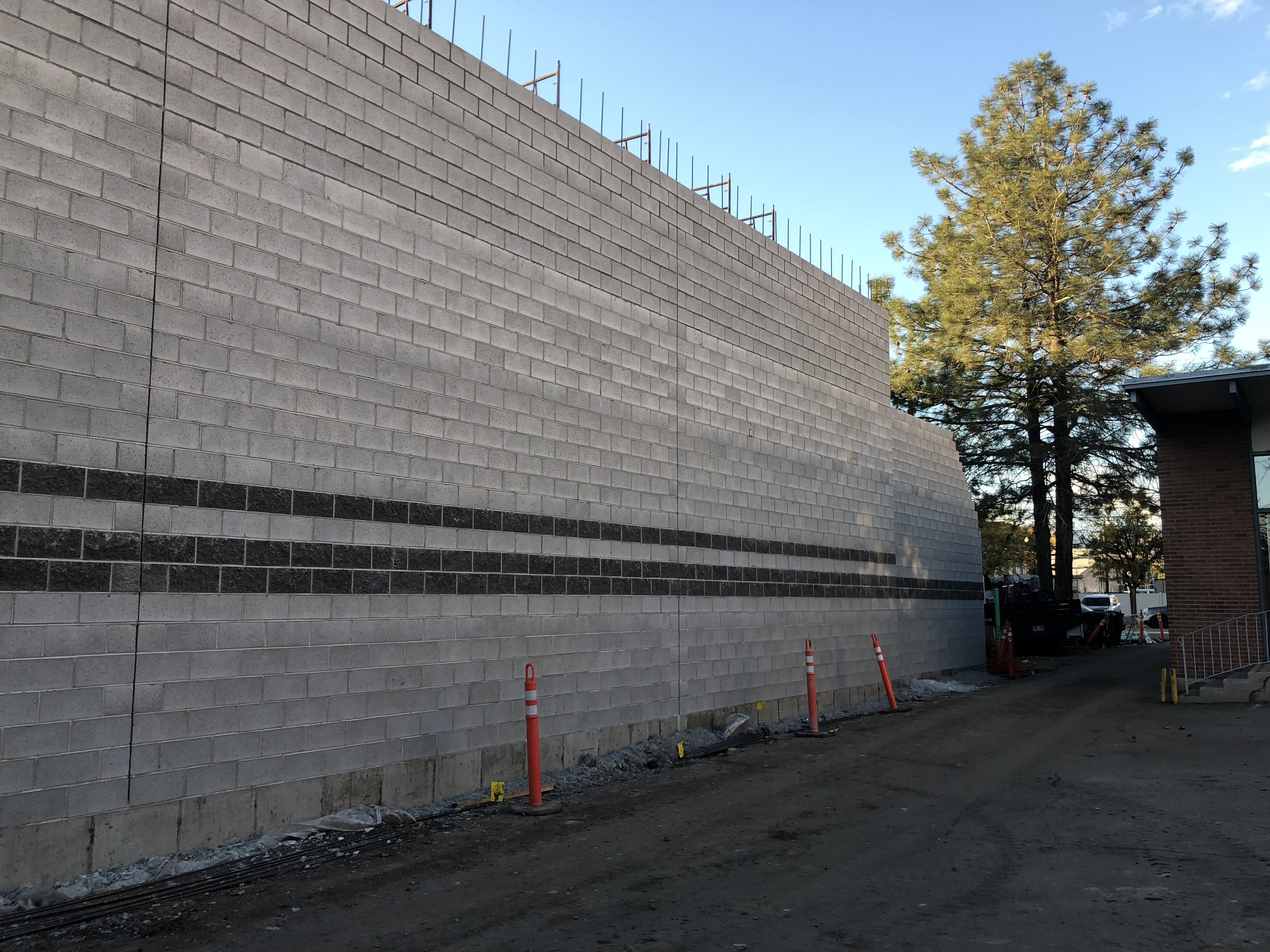 East wall, lower section is the lobby out in front of the higher studio spaces.
