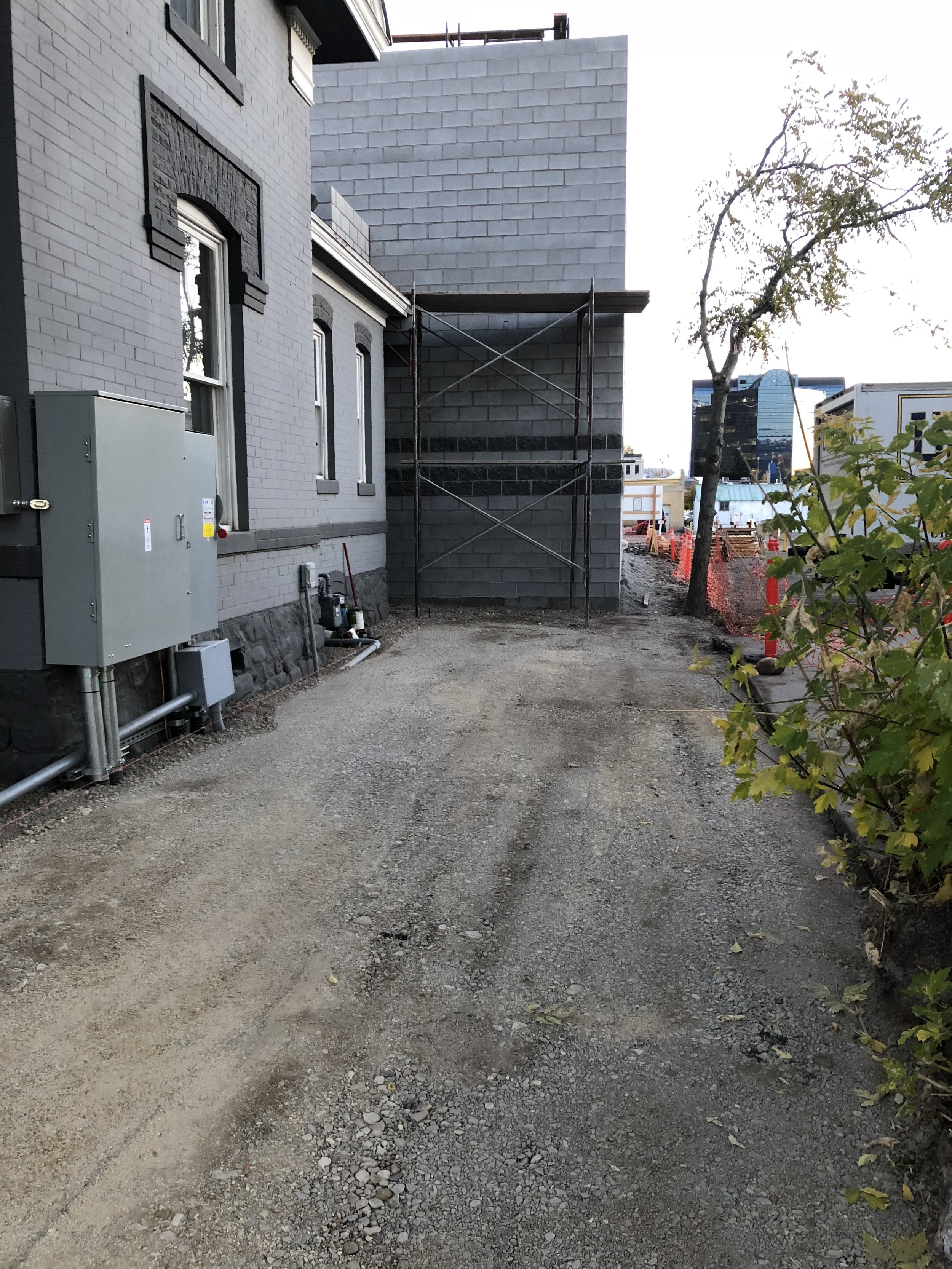 Looking down the west side of the house, the driveway and pathways are nearly set for concrete. Looking forward to having something other than dirt for clients to walk in on!