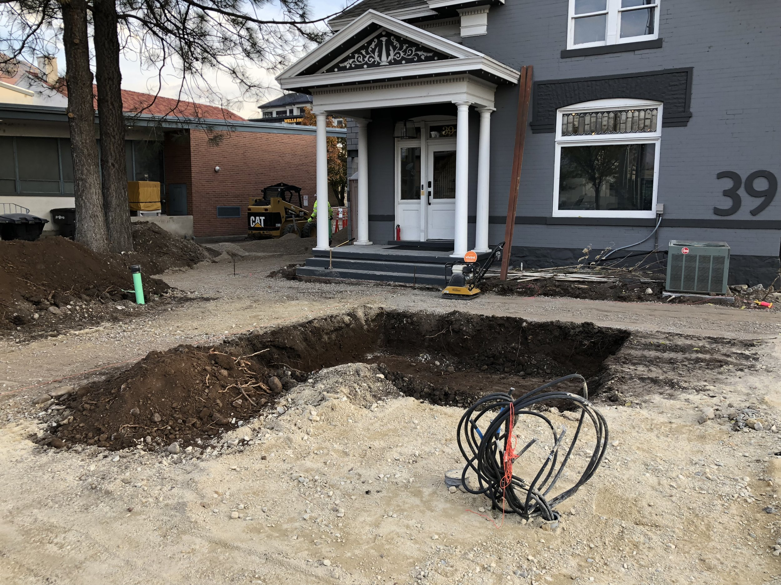 The cable coming out of the ground will feed the large transformer that the city requires. Behind you can see the beginnings of a fire pit / seating area we will be putting in the front yard.