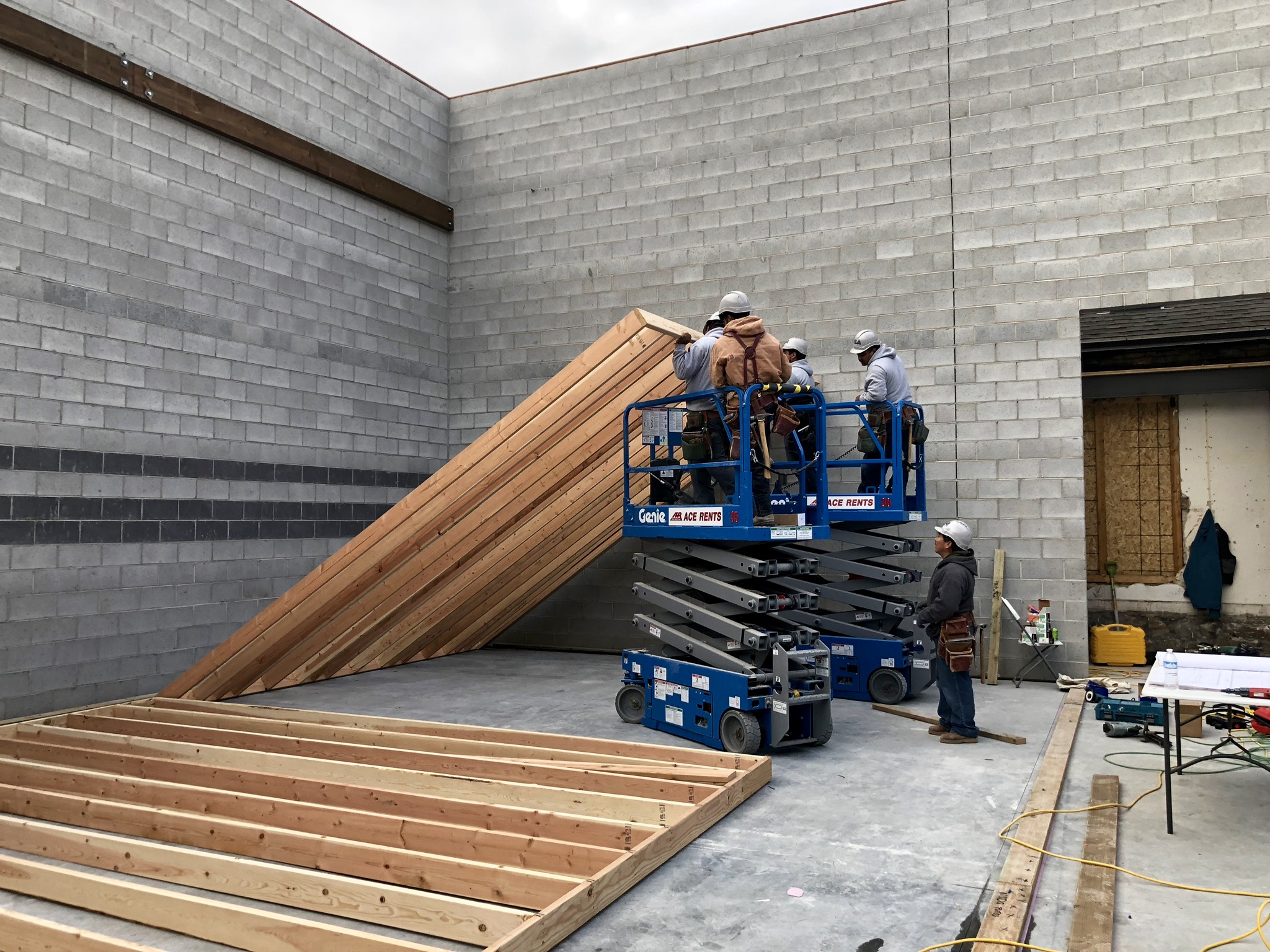 Raising the first wall - west side of studio 1 and the booths. Pretty sure this method the framers are using wouldn't be OSHA approved, it can be pretty sketchy at times, but its quite entertaining to watch.