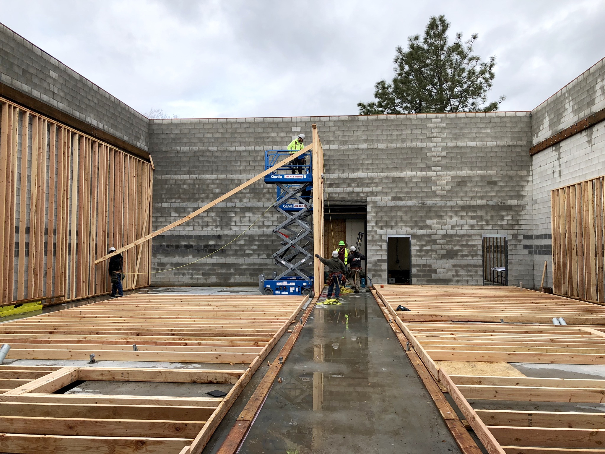 """First wall of the hallway, the trusses will rest and """"handshake"""" on the hallway walls. Looking north toward the back of the house, studio 1 on the left, studio 2 on the right."""