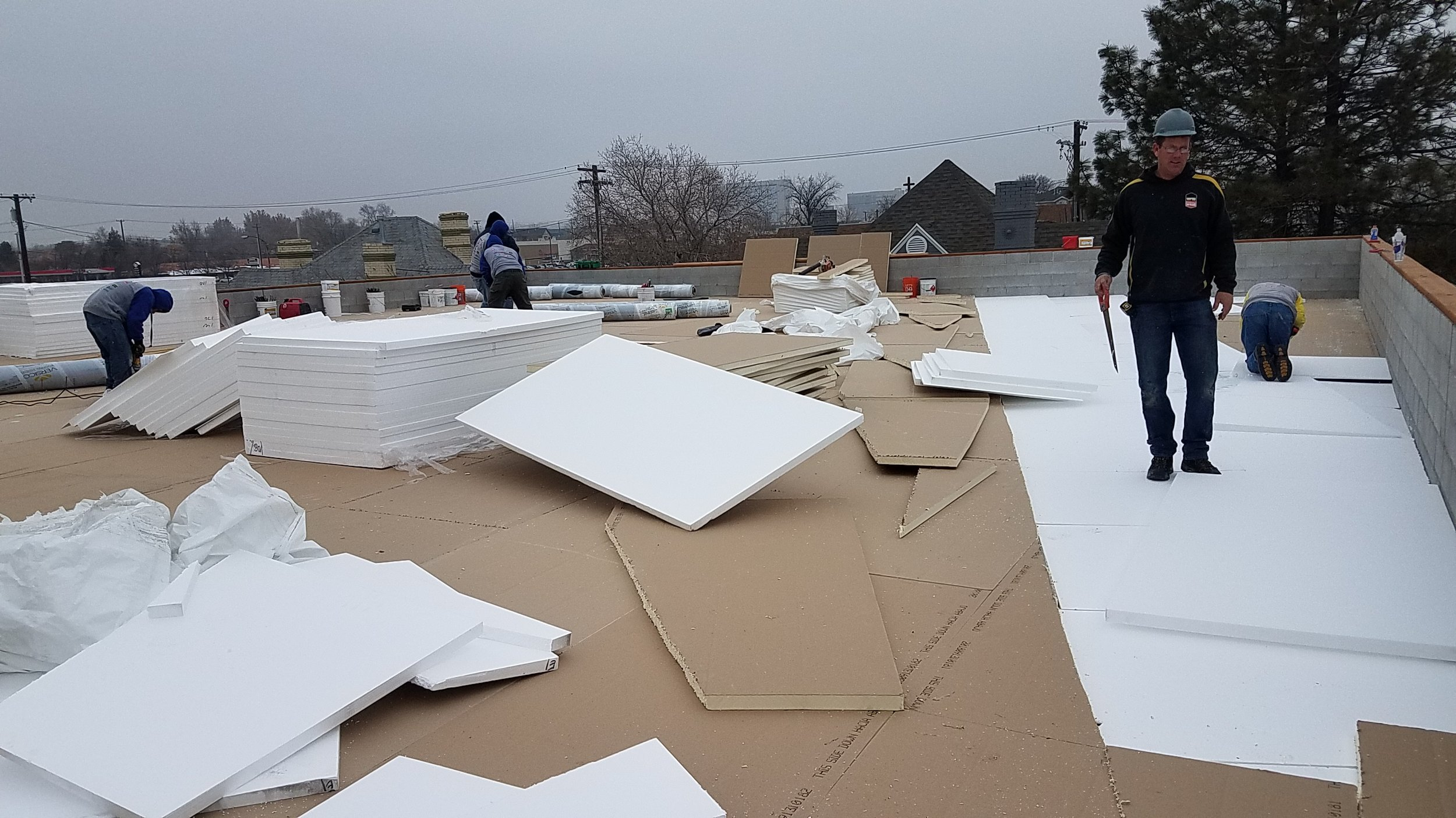 Setting the foam insulation on the roof.
