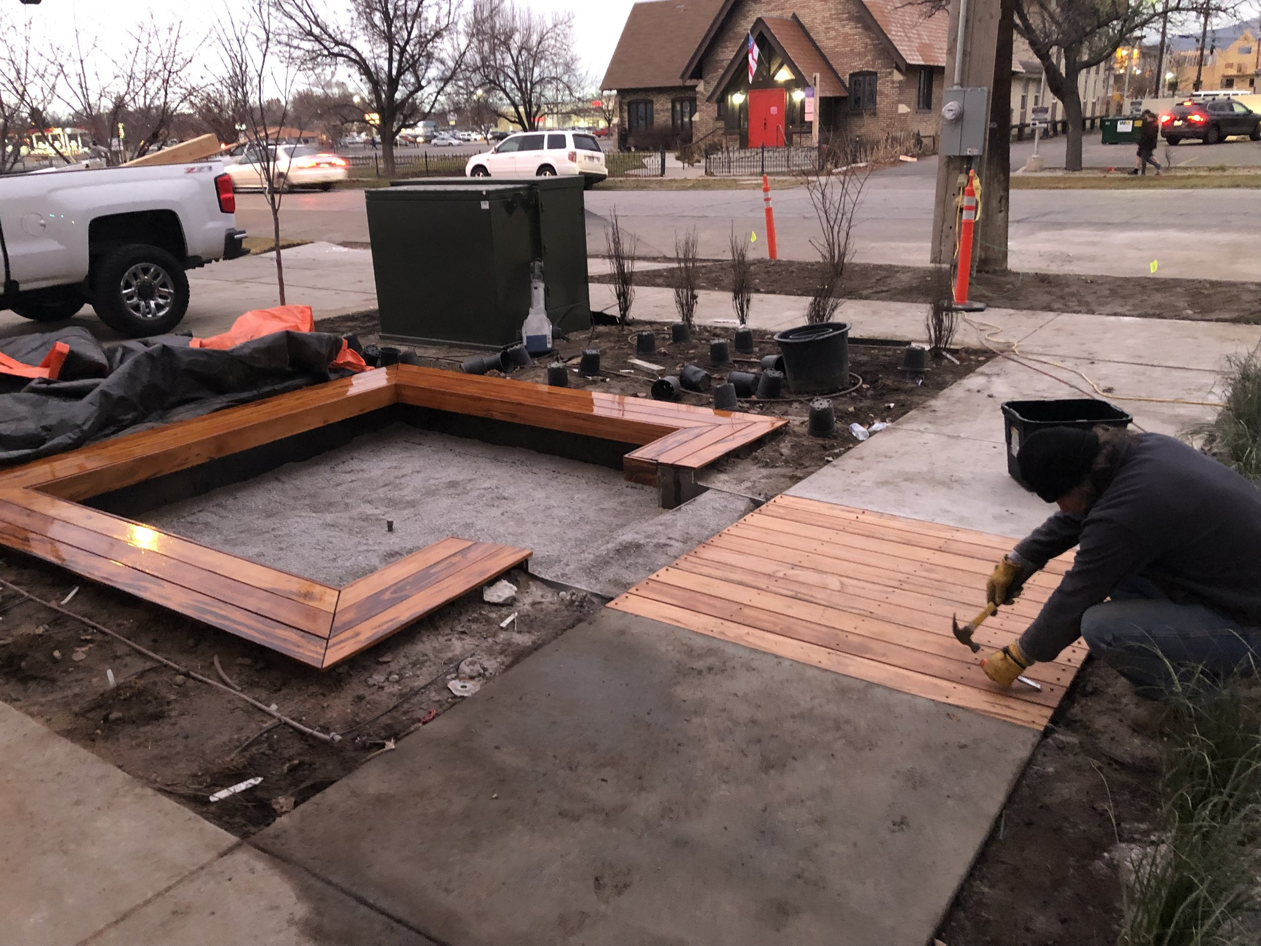 """Before Christmas we had some warm weather and the landscapers continued to work out front. The fire pit on the left was finished and the """"boardwalk"""" was installed."""
