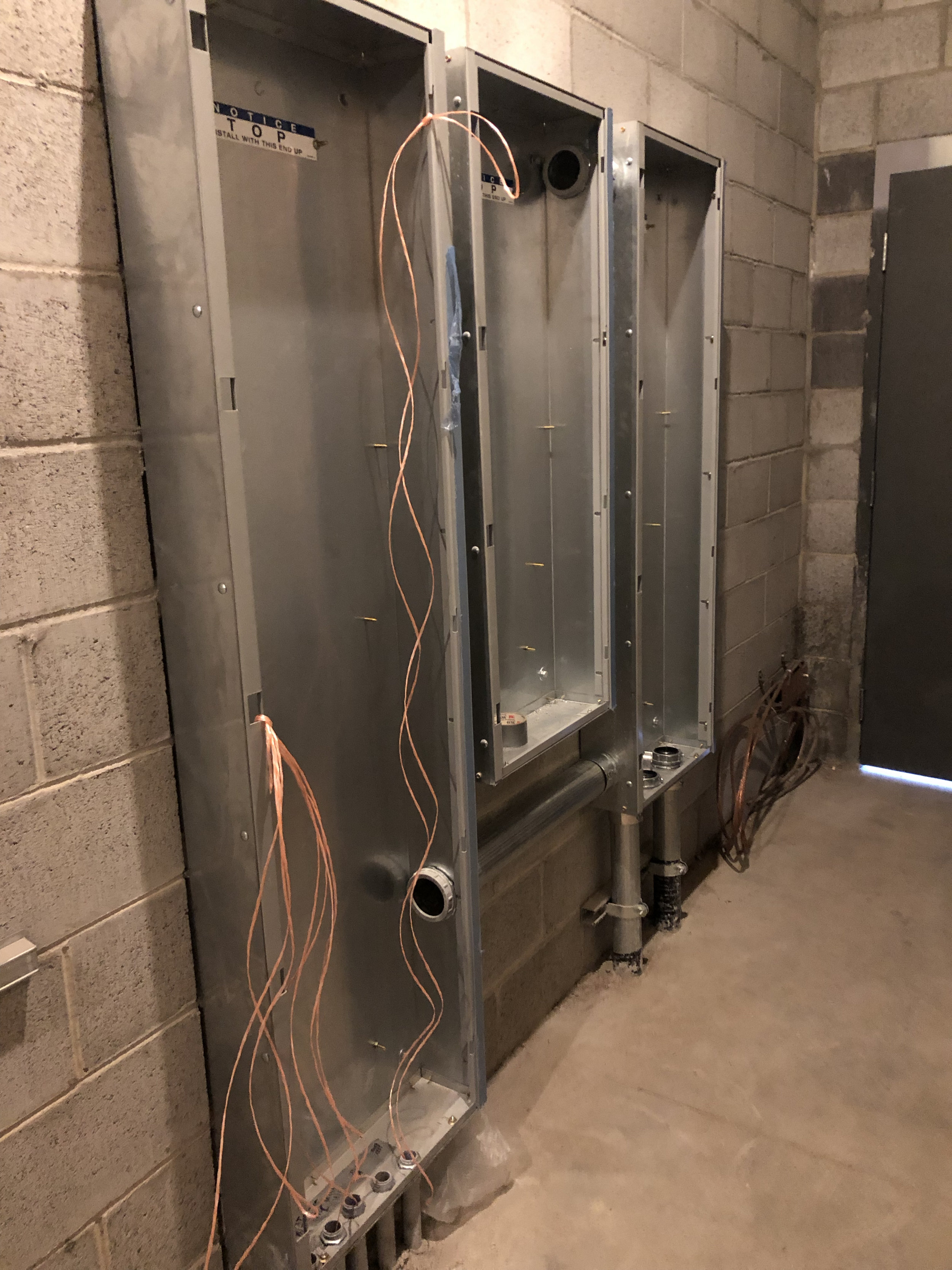 The electricians started their interior work by setting the panels and getting the nylon pull tape in the conduits.