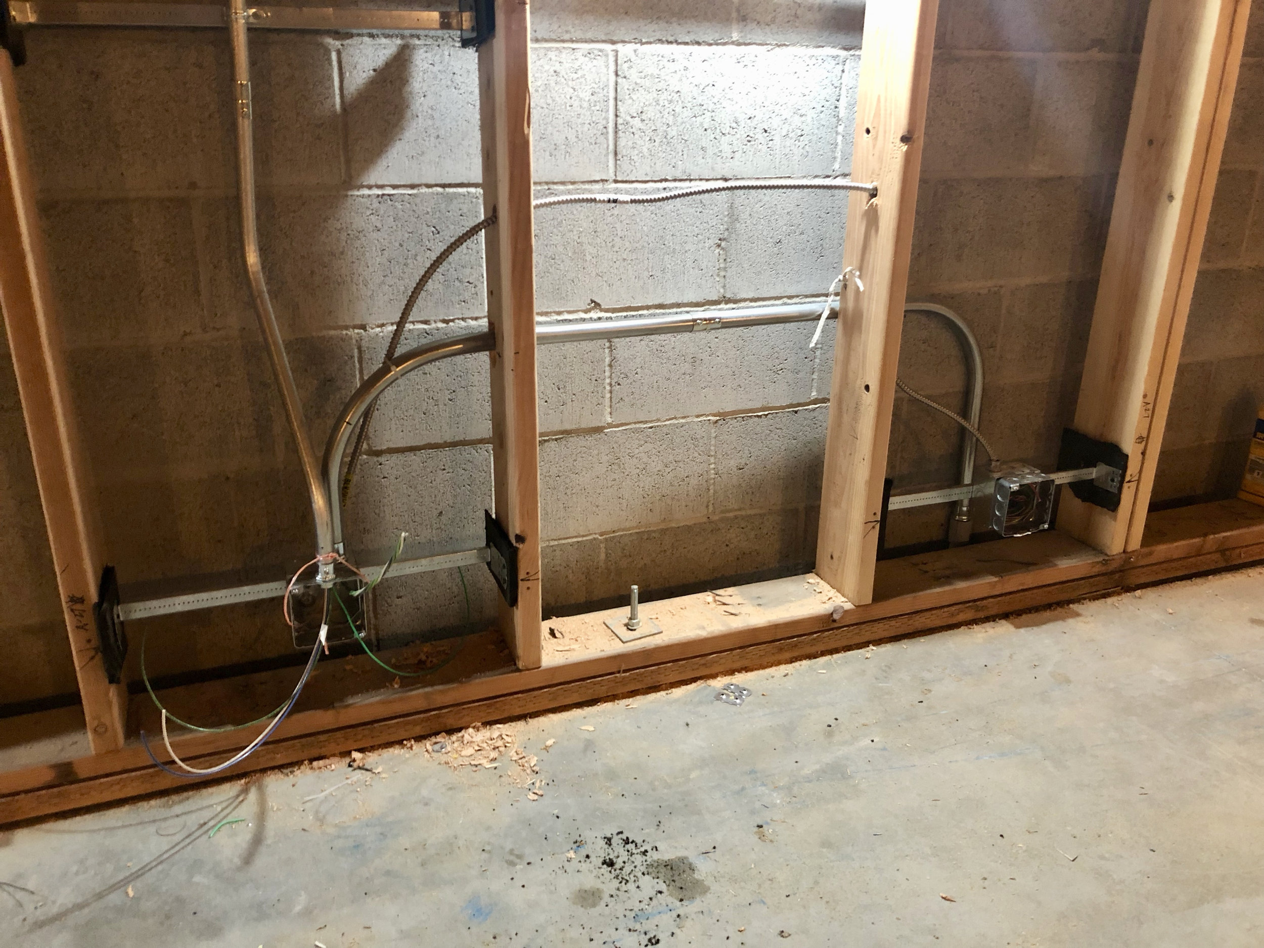 The electricians made some headway this week. There was some discussion as to how to mount the electrical boxes and keep them isolated from the framed walls but sitting in the sheetrock and other acoustic materials which will be mounted. The solution was to use some isolation material between the mounting hardware for the electrical and the framing.