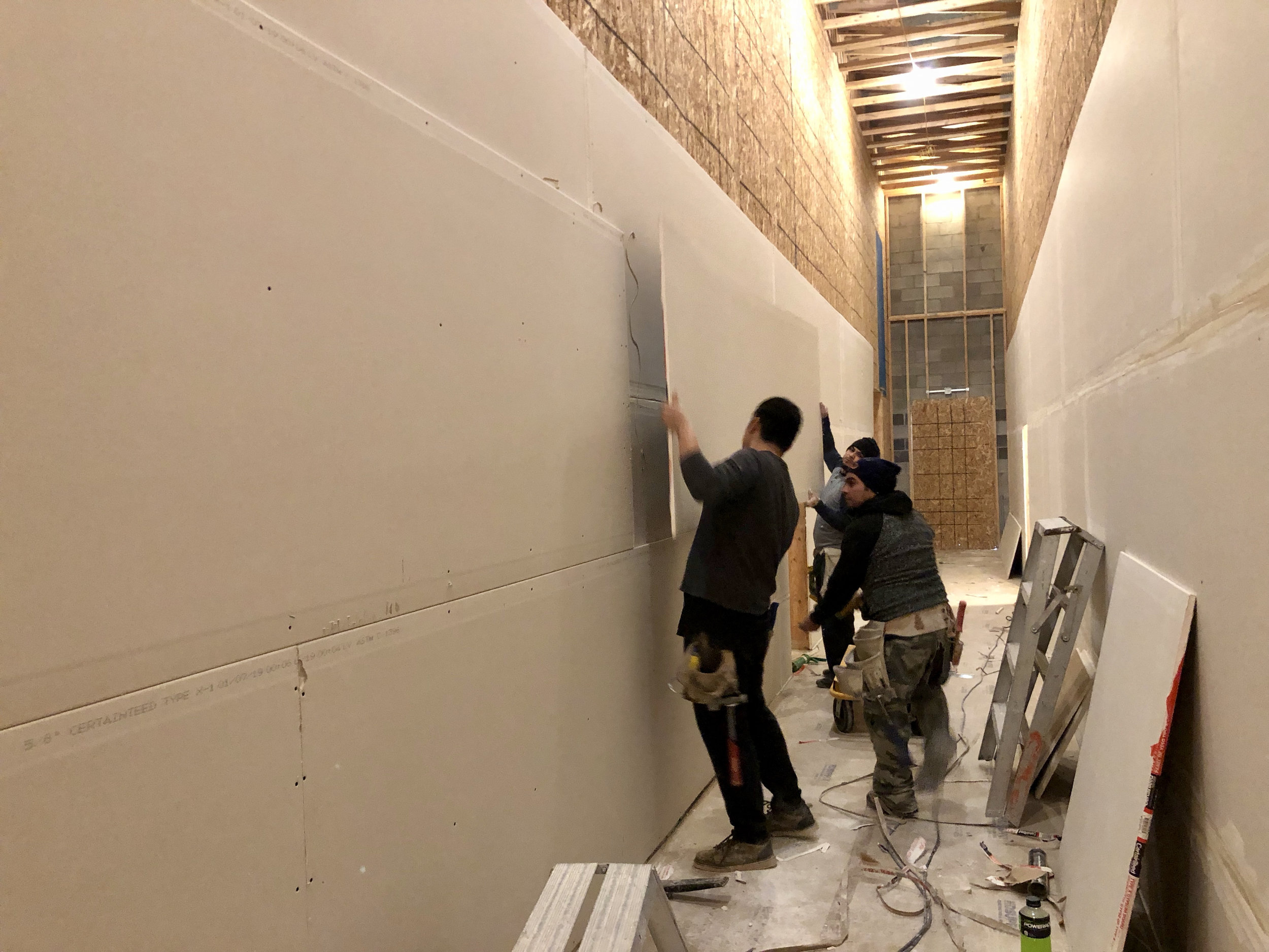 Sheetrock began in the hallway. 2 layers of 5/8' with staggered seems in the hallway. Both layers were taped and mudded.