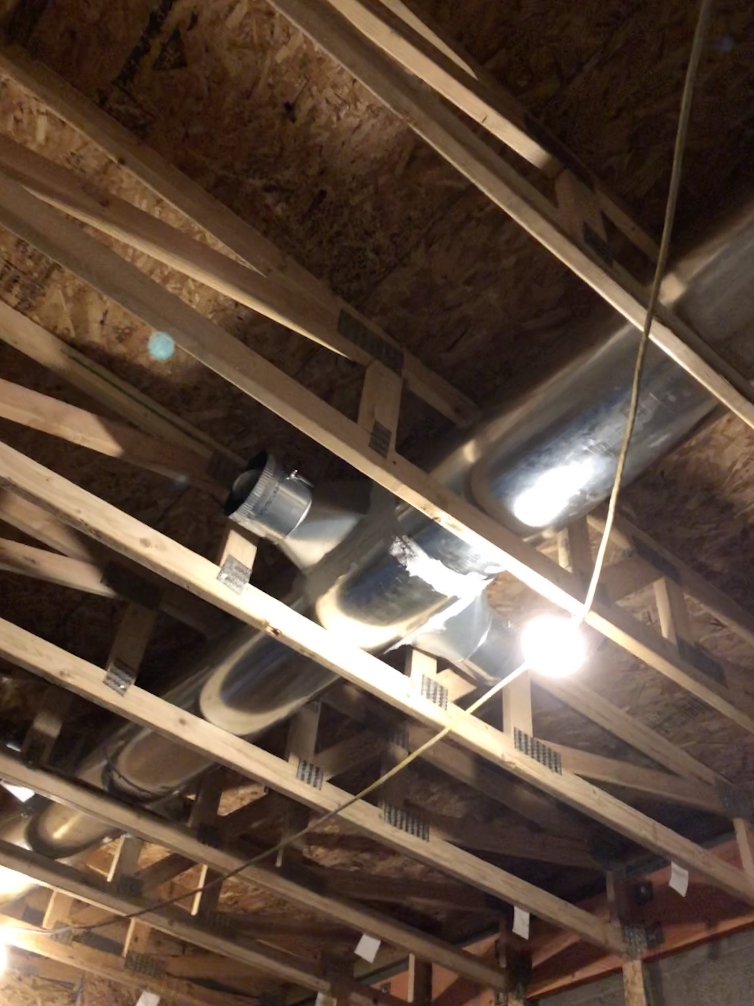 HVAC work began with some duct work in the lobby. Some careful planning allowed for the ducts to live in the trusses and buy us some much appreciated ceiling height.