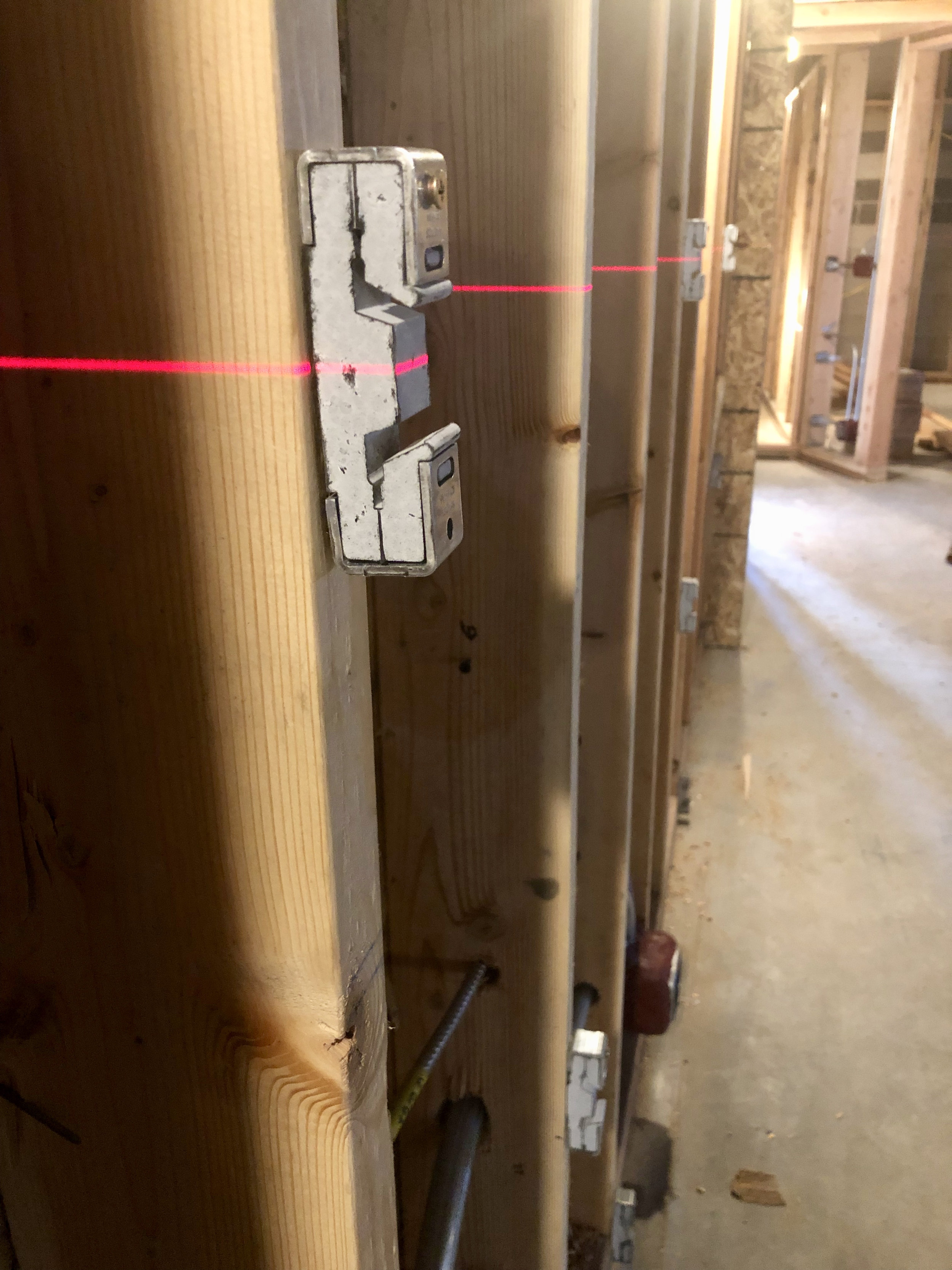 The clips are screwed into the studs and then the hat channel hangs in the clips. The rubber material helps isolate the sheetrock from the studs and drops the sound transmission through the walls significantly.