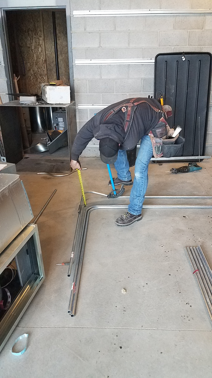The electricians take great care with their installation. Here he is precisely bending conduit that will be hidden behind sheetrock and never seen again.
