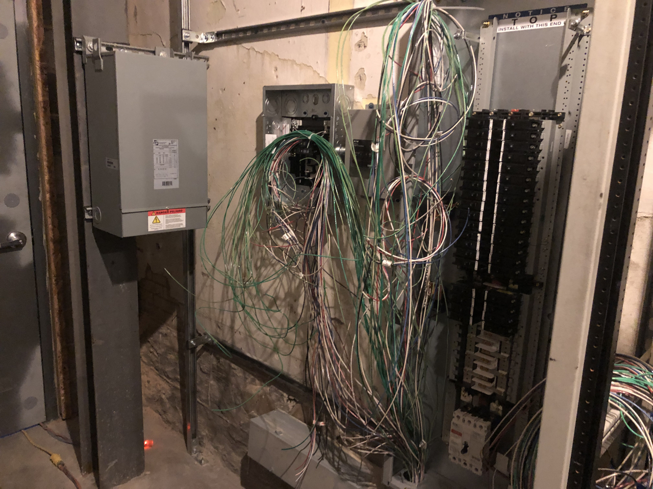 The transformer is hung on the left, in the middle is a disconnect and a surge protector, on the right is the panel for the clean power to the studios.