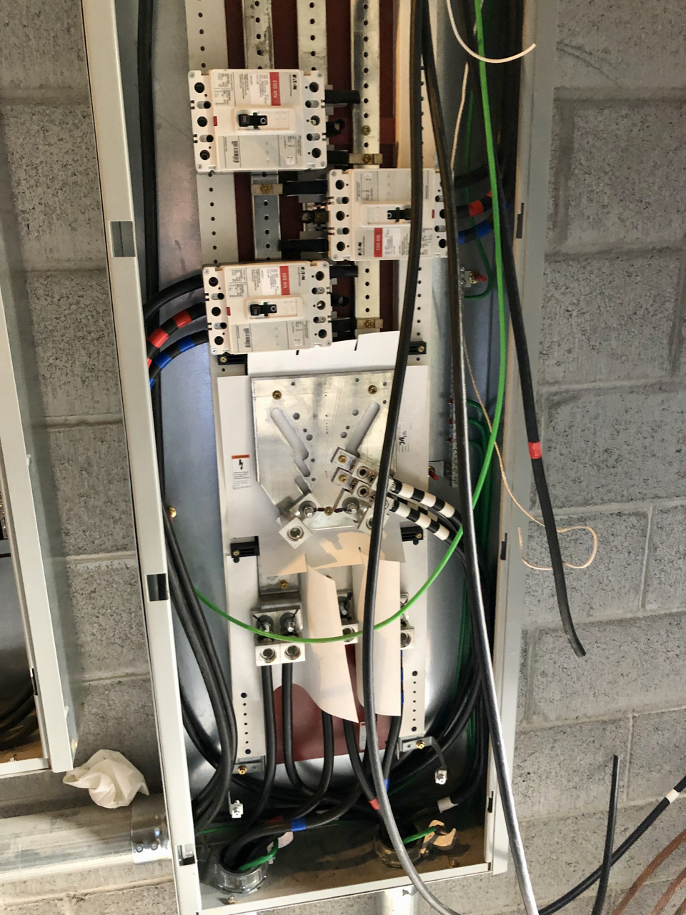 This is the main distribution panel inside. Power comes in the bottom and then is split via the three breakers to the house, the dirty power for the new space and the clean power for the new space.