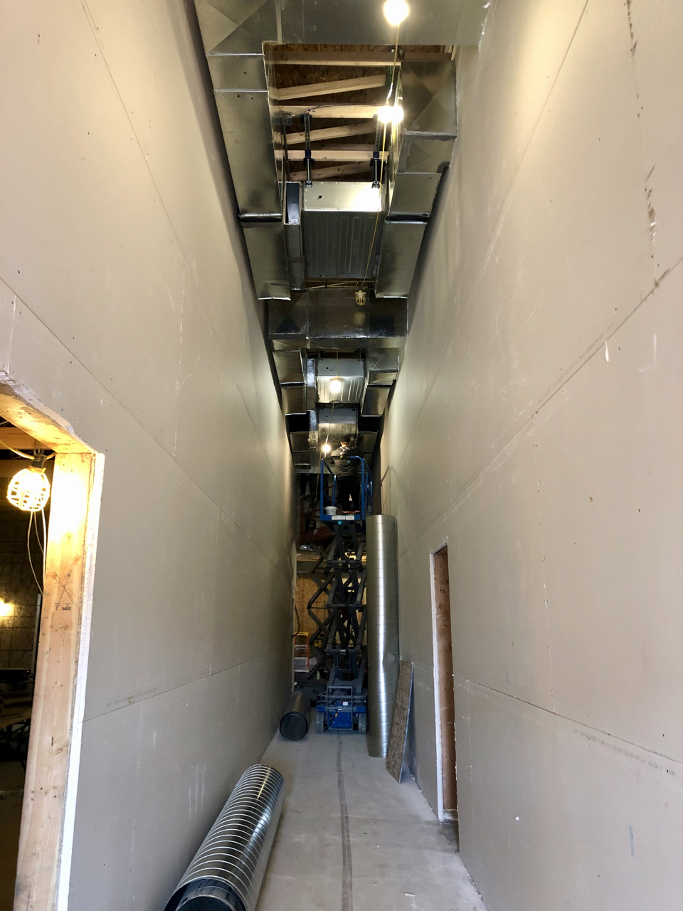 Ductwork continues in the center hallway.