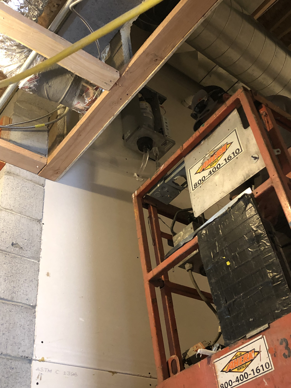 Just above the lift you can see the steam humidifier that is being installed in order to raise the humidity of the instrument gallery.