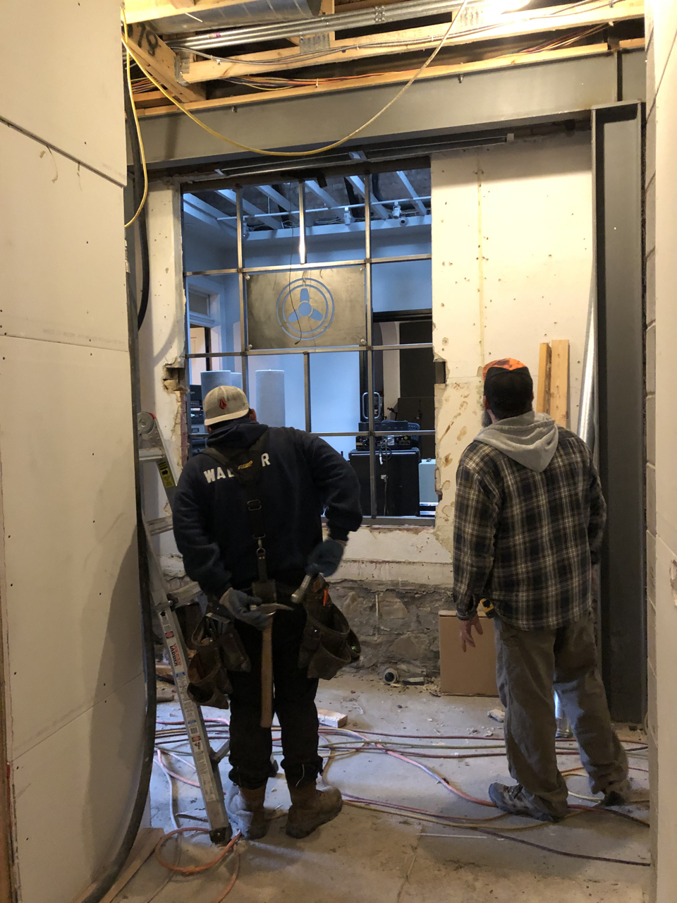 We removed the temporary wall that separated the future lounge / kitchen which is in the rear of the house from the hallway of the new space. It was exciting to get a sense for how these two spaces will work together.